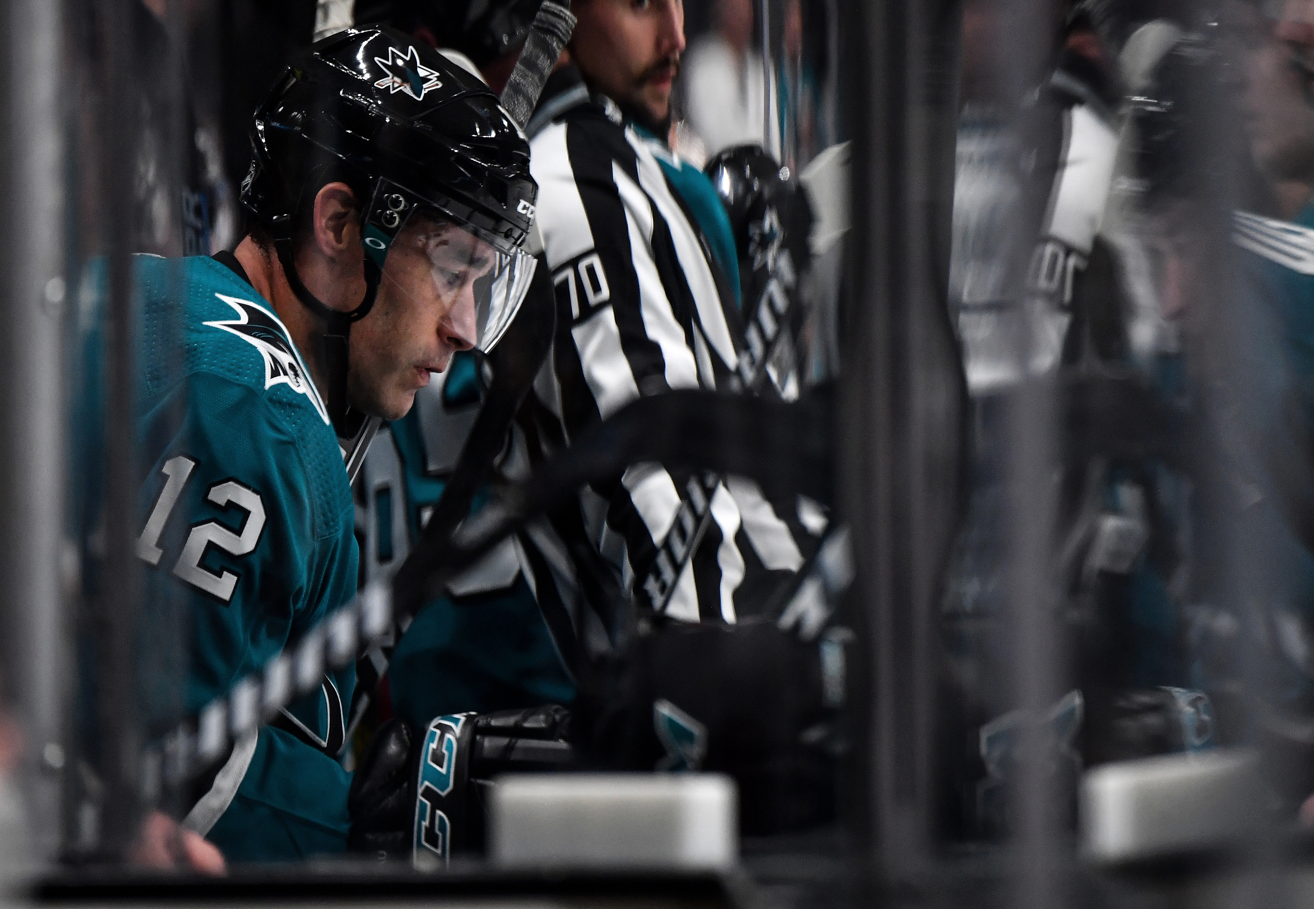 SAN JOSE, CA - OCTOBER 13: Patrick Marleau #12 of the San Jose Sharks sitting on the bench against the Calgary Flames at SAP Center on October 13, 2019 in San Jose, California.