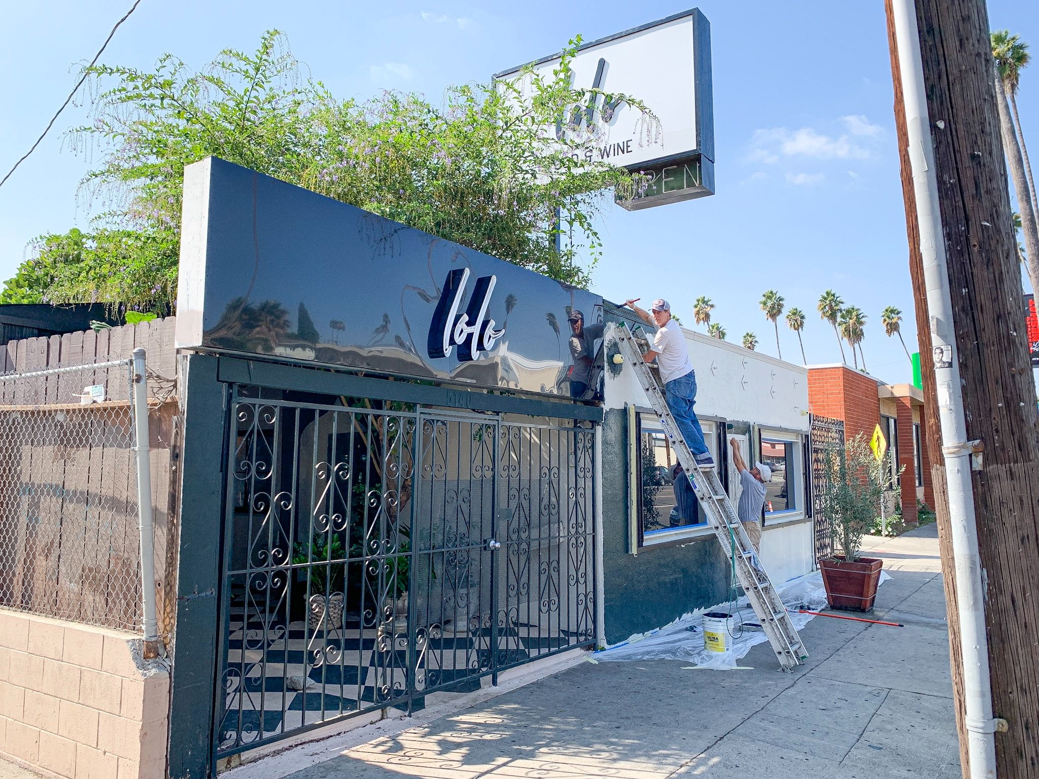 A new wine bar gets a fresh coat of black paint on the exterior.