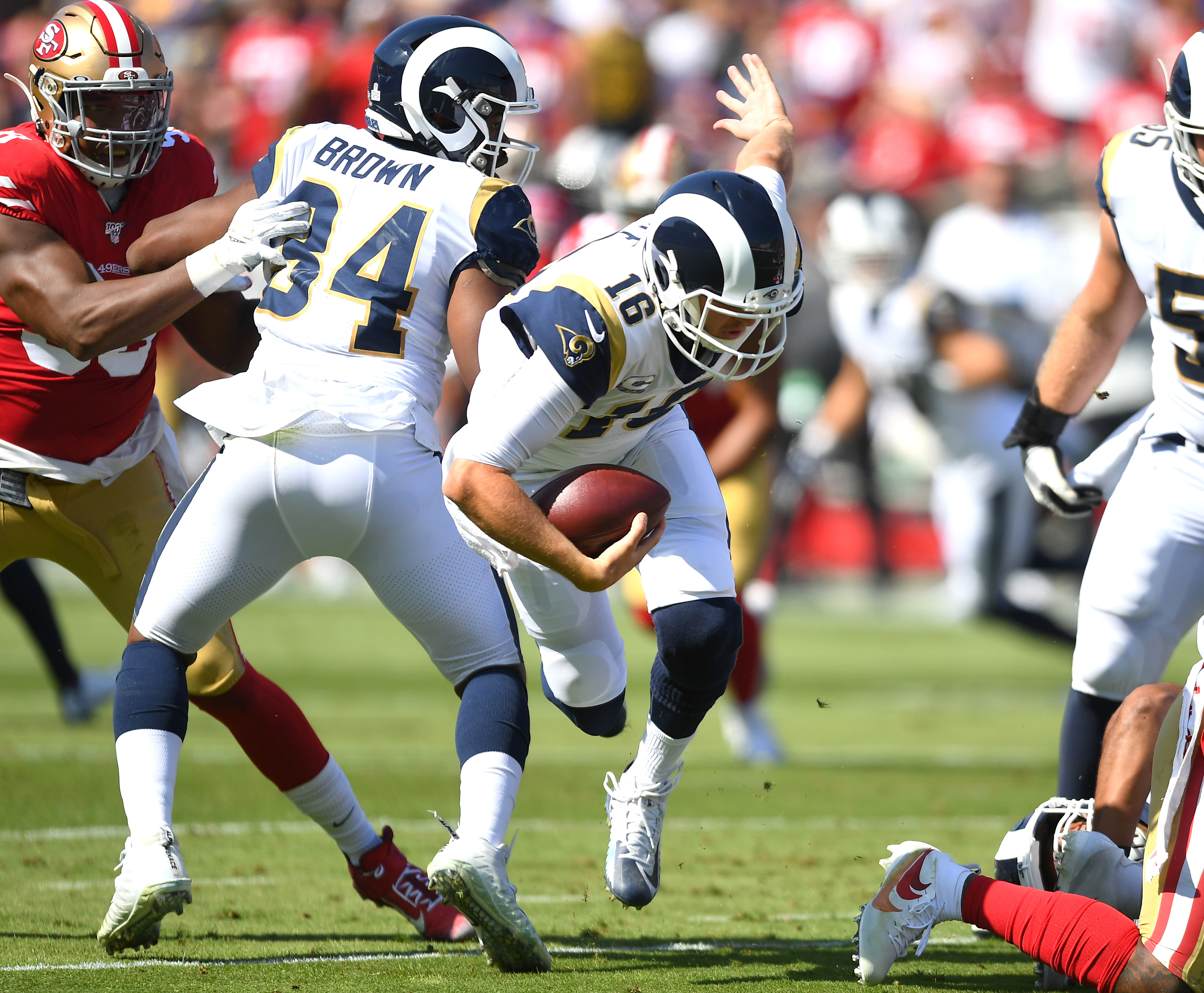 Los Angeles Rams QB trips trying to escape the San Francisco 49ers' defense in Week 6, Oct. 13, 2019.