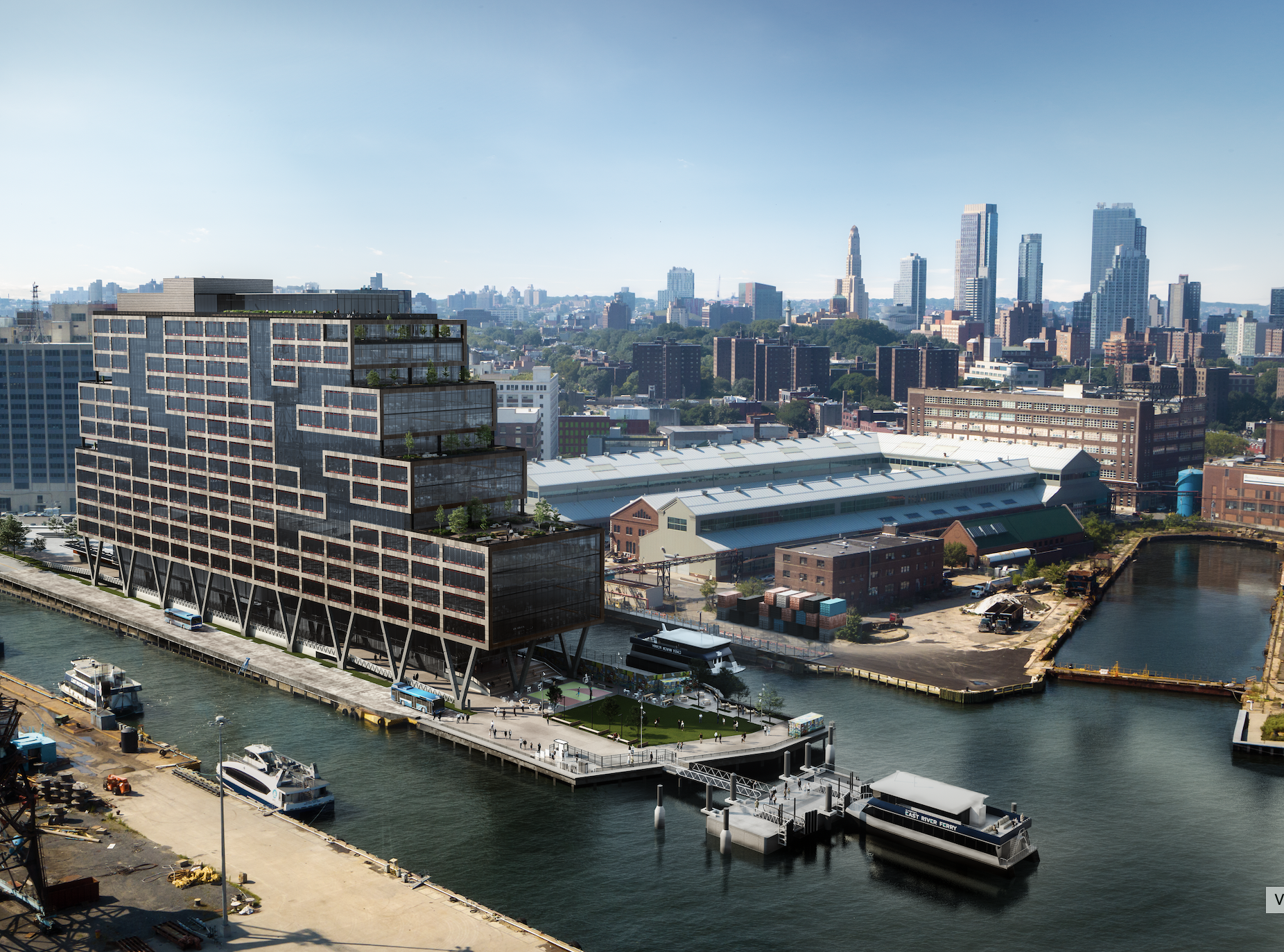 A 16-story waterfront building with a grid and large windows. The Manhattan skyline can be seen in the back.