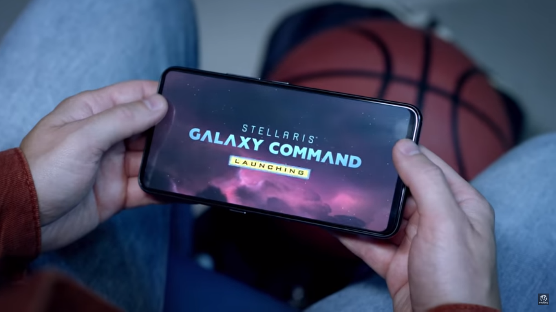 A phone with Stellaris: Galaxy Command on the screen