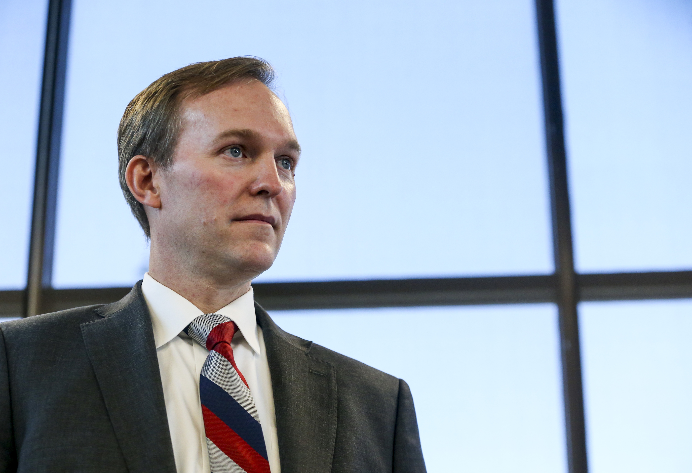 FILE - Rep. Ben McAdams prepares to speak about the impeachment inquiry following a town hall on aging adult and senior issues at the Midvale Senior Center in Midvale, Utah, on Friday, Oct. 4, 2019.