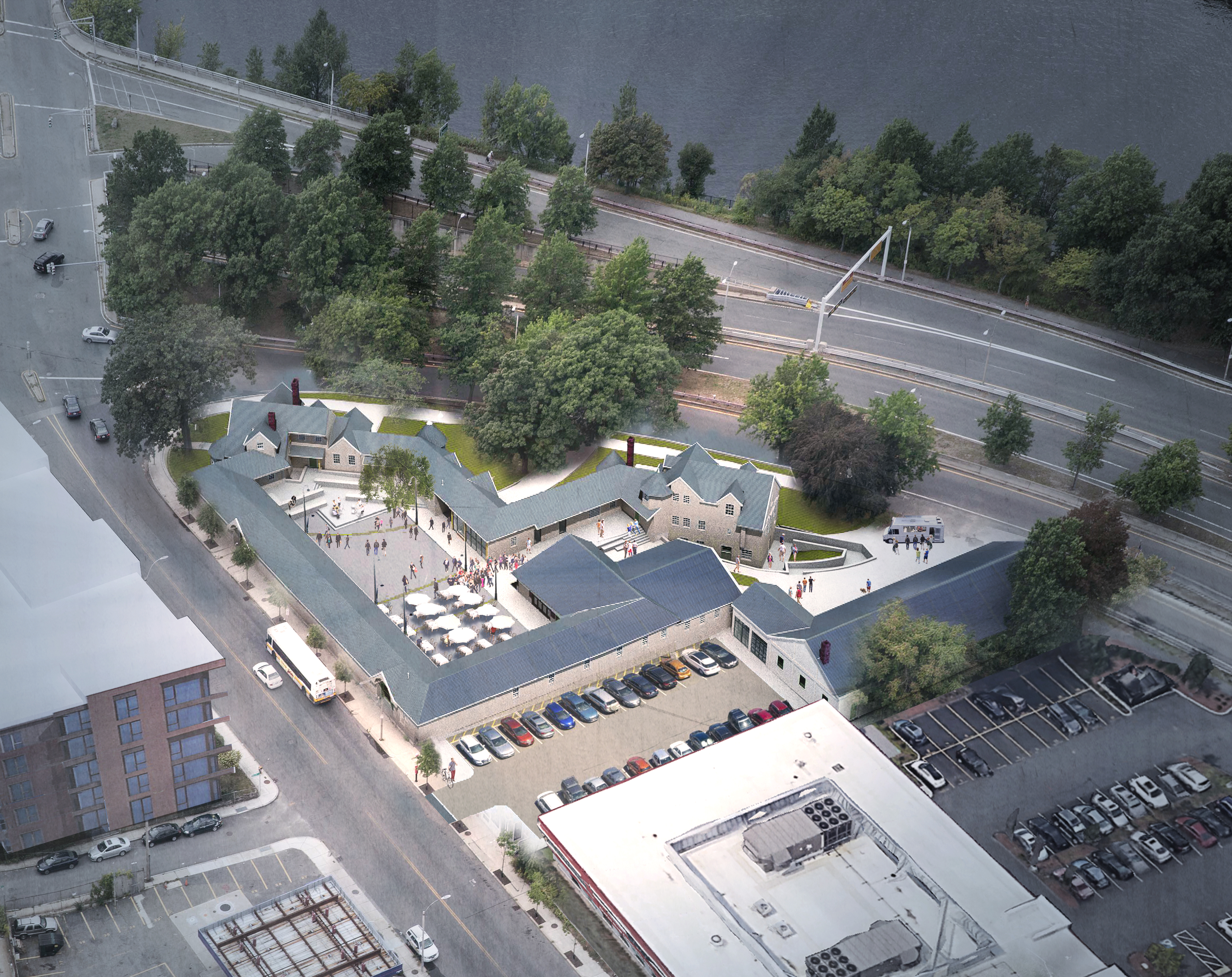 An aerial view of a multibuilding rendering of a brewery and common areas, and it's all beside a major highway.