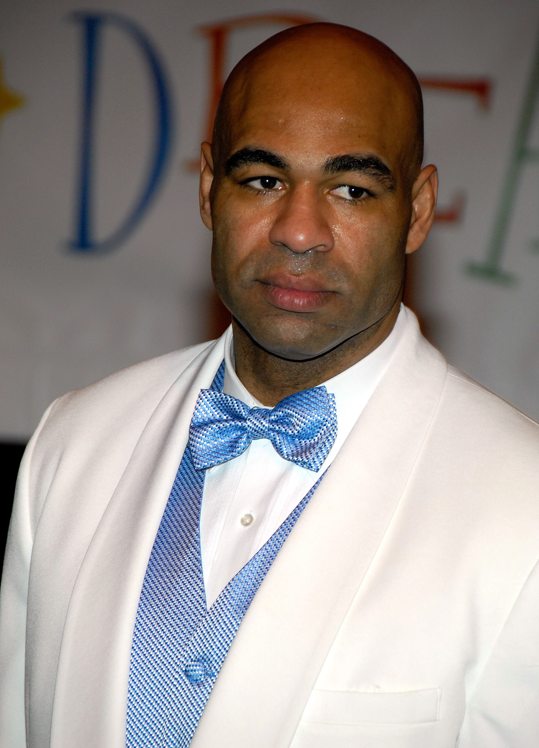 Donald Brashear in a white suit with a blue vest and bowtie.