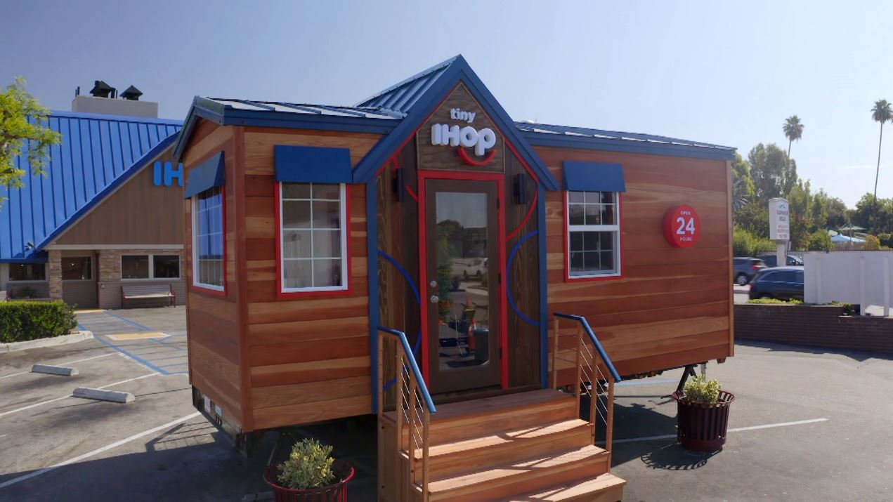 A tiny version of an IHOP restaurant on a trailer.
