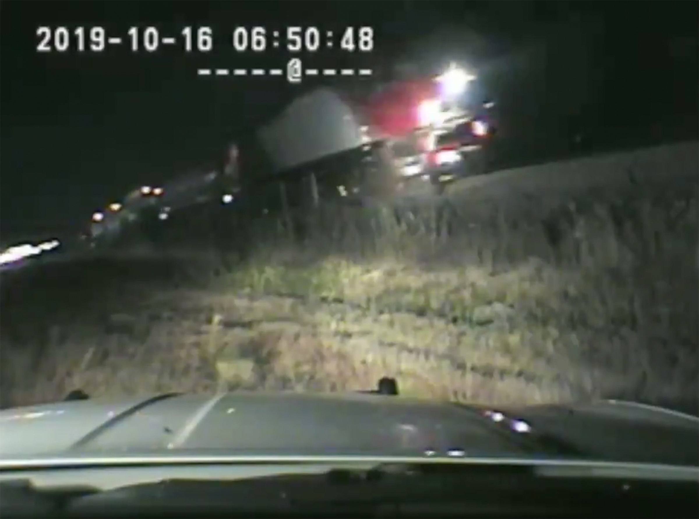 This still frame from a Utah Highway Patrol dashcam shows a FrontRunner train impacting an SUV 1 second after trooper Ruben Correa pulled an unconscious man from the driver's seat on the morning of Wednesday, Oct. 16, 2019 in Centerville.