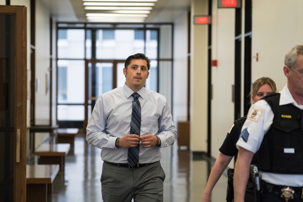 Chicago police officer Robert Rialmo, the officer who shot and killed Quintonio LeGrier and Bettie Jones in December 2015, is shown leaving court at the Daley Center earlier this week. LeGrier's father testified Thursday, and his testimony contradicted so
