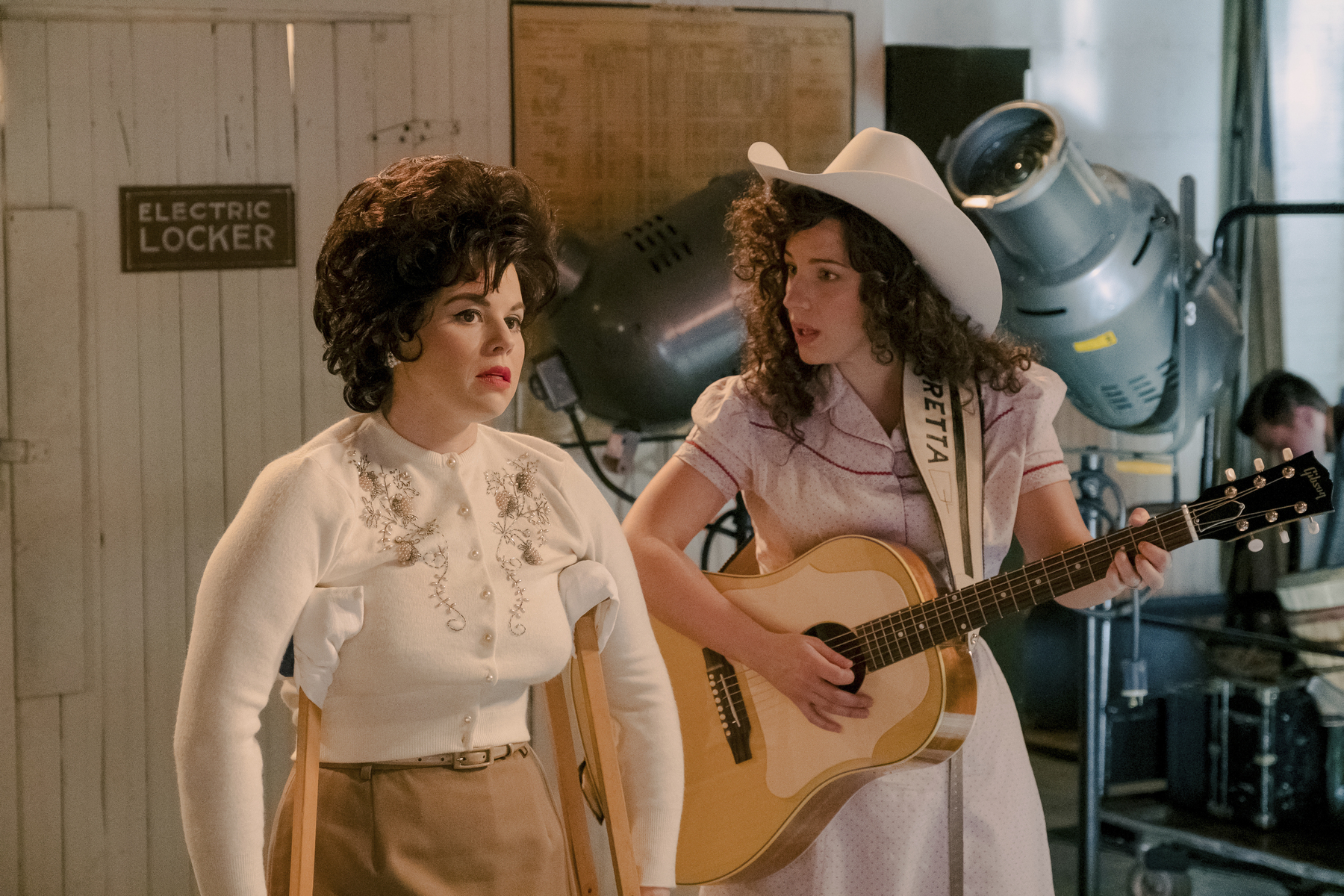 "Jessie Mueller stars as Loretta Lynn (right) and Megan Hilty portrays Patsy Cline in a scene from ""Patsy & Loretta."" airing on Oct. 19 on Lifetime."