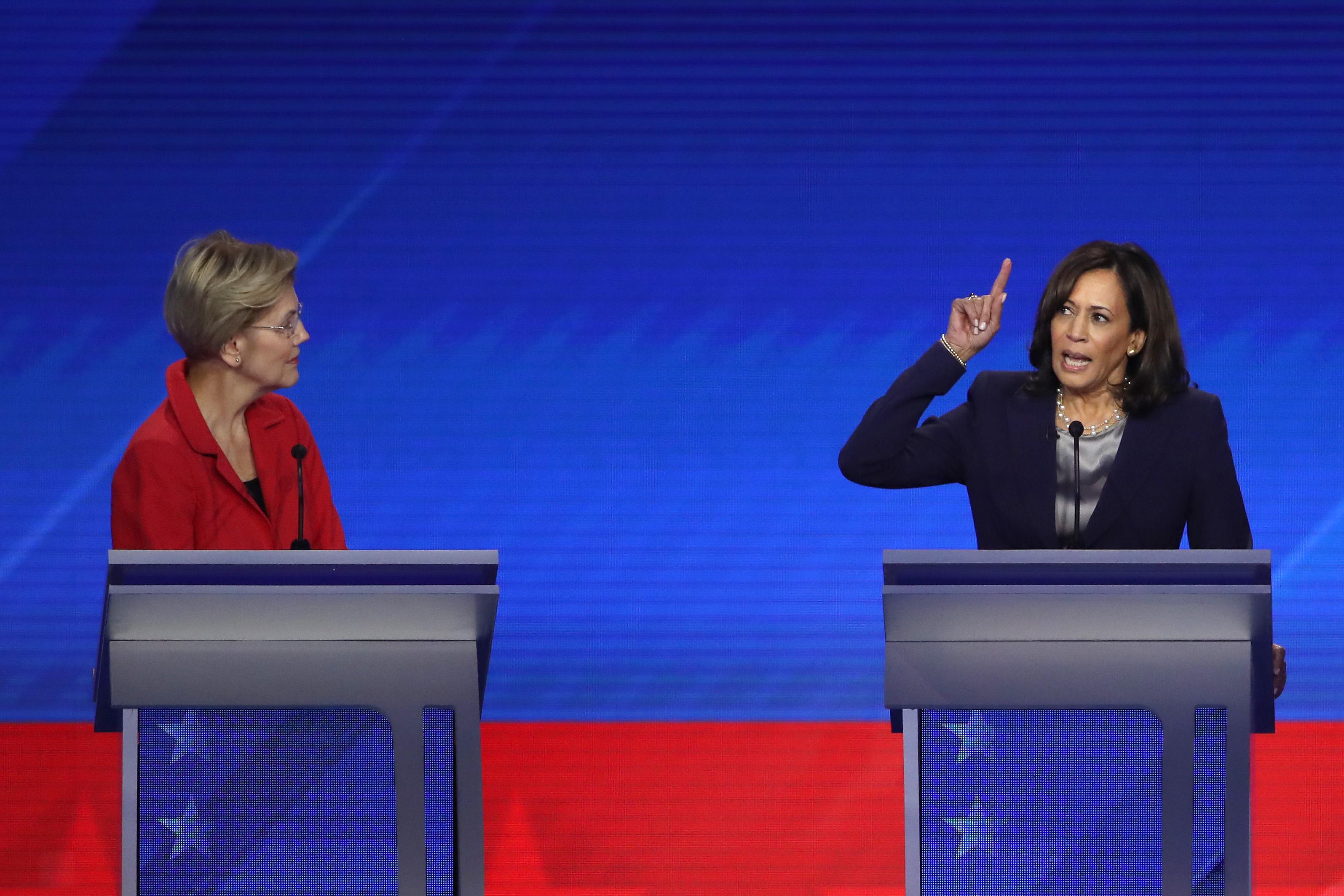 Elizabeth Warren and Kamala Harris at their podiums at the fourth Democratic debate.