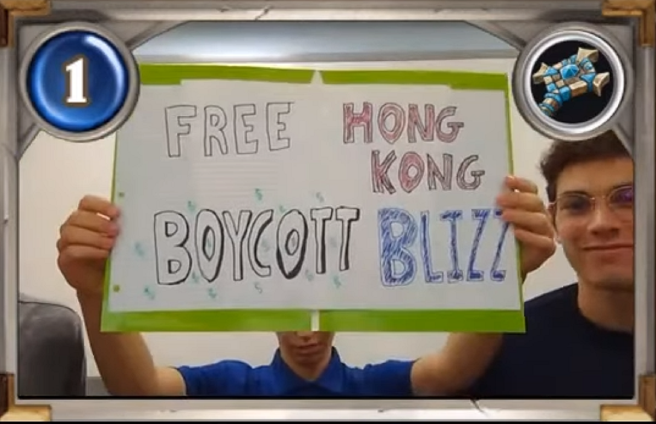 """American University Hearthstone players holding a sign that reads """"Free Hong Kong, Boycott Blizz"""""""
