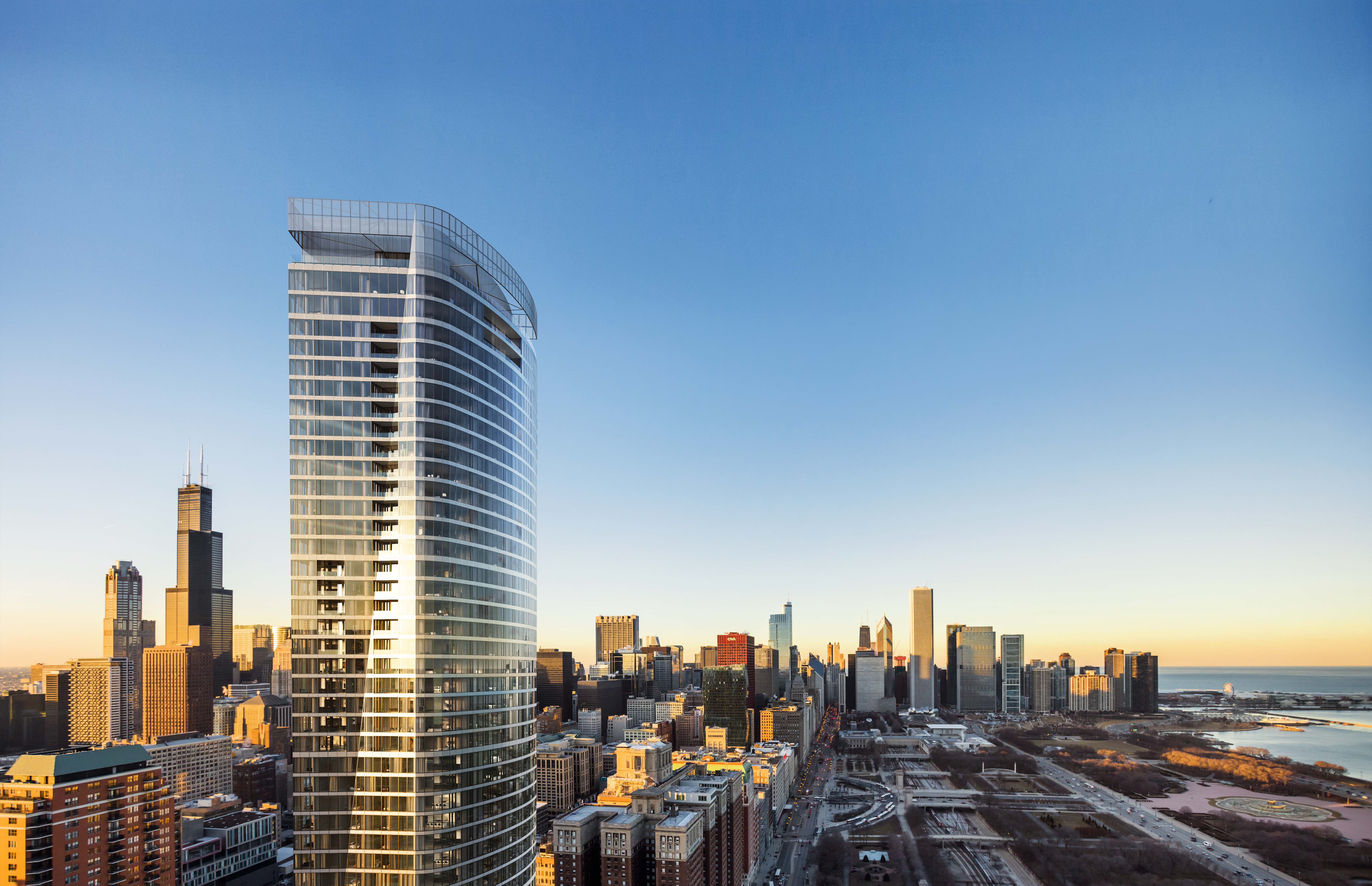 A rendering of the top of a glassy contemporary tower standing next to a park. A row of tall buildings and a large body of water can be seen in the distance.