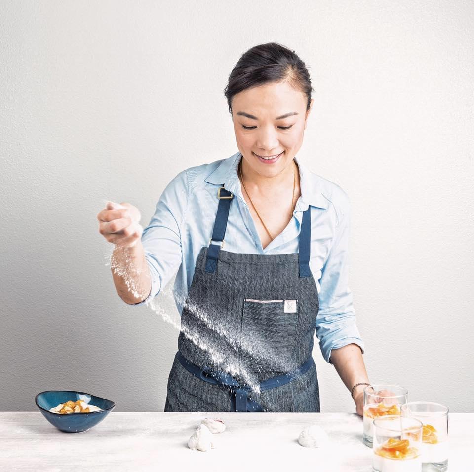 A chef tosses flour on a table