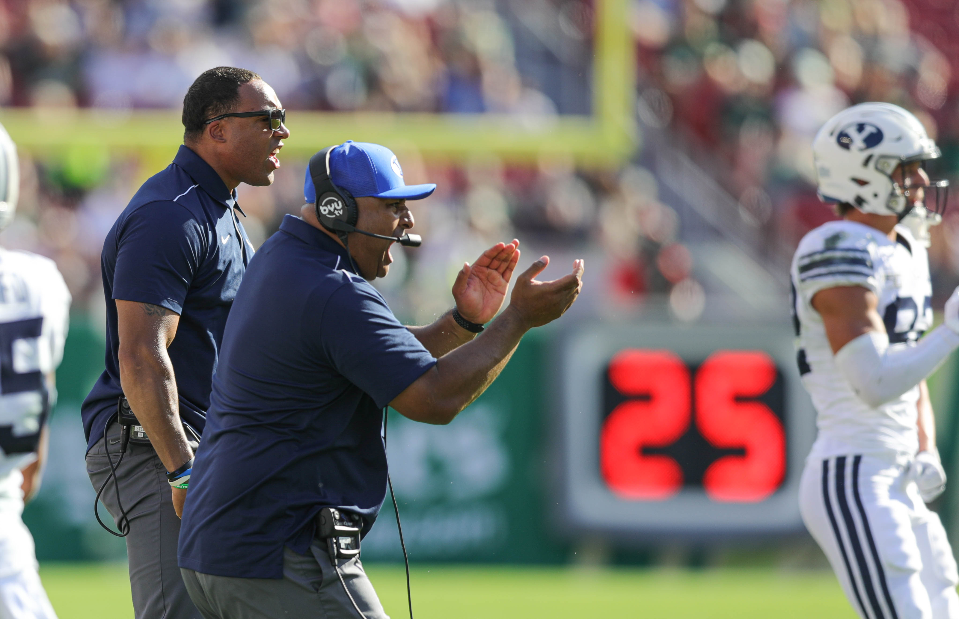 BYU head coach Kalani Sitake and running backs coach AJ Steward react to a touchdown in the first half against the USF Bulls at Raymond James Stadium in Tampa, Florida, on Saturday, Oct. 12, 2019.