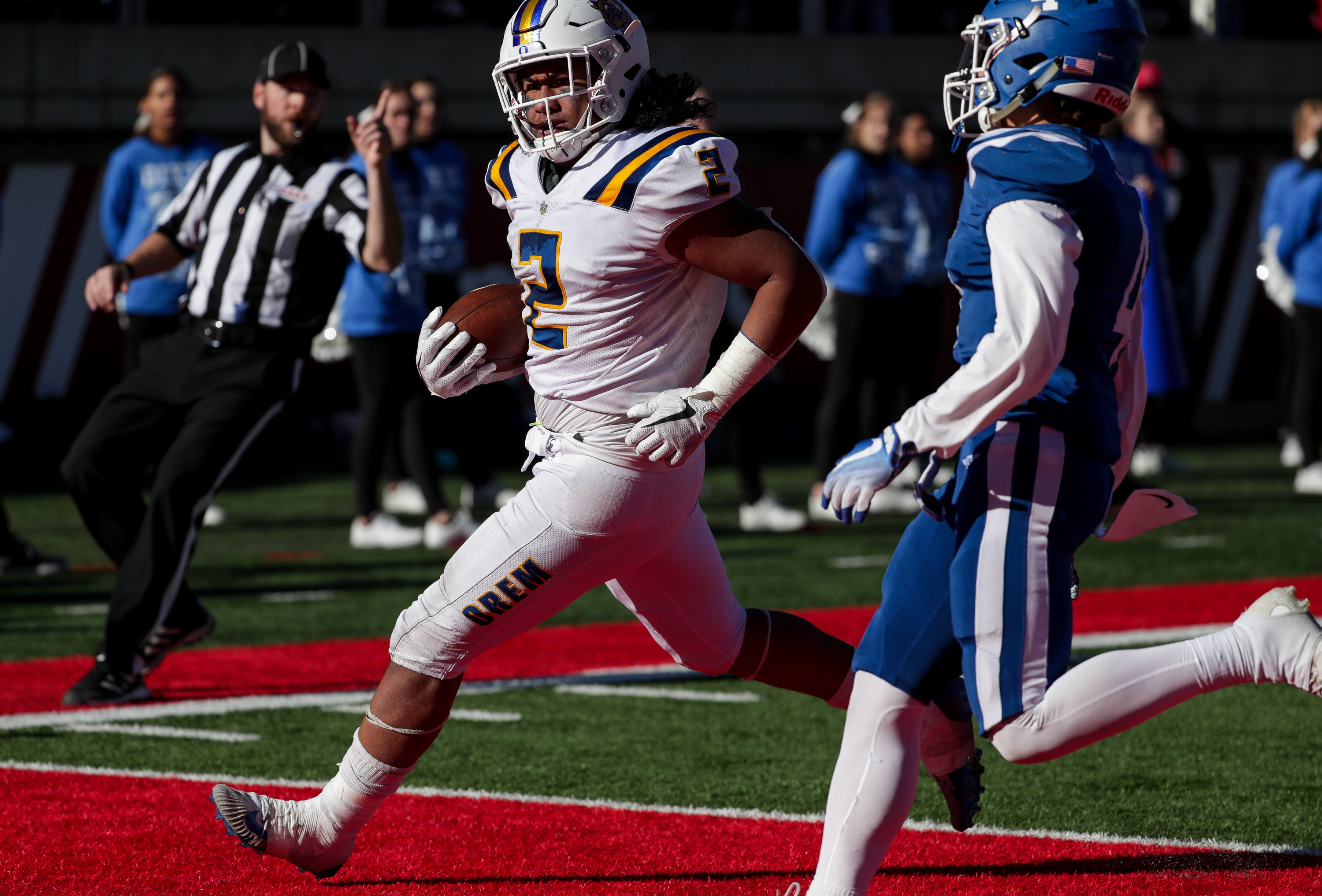 Orem's Noah Sewell runs the ball in for a touchdown, putting Orem up 60-13 over Dixie, in the 4A football state championship game at Rice-Eccles Stadium in Salt Lake City on Friday, Nov. 16, 2018.