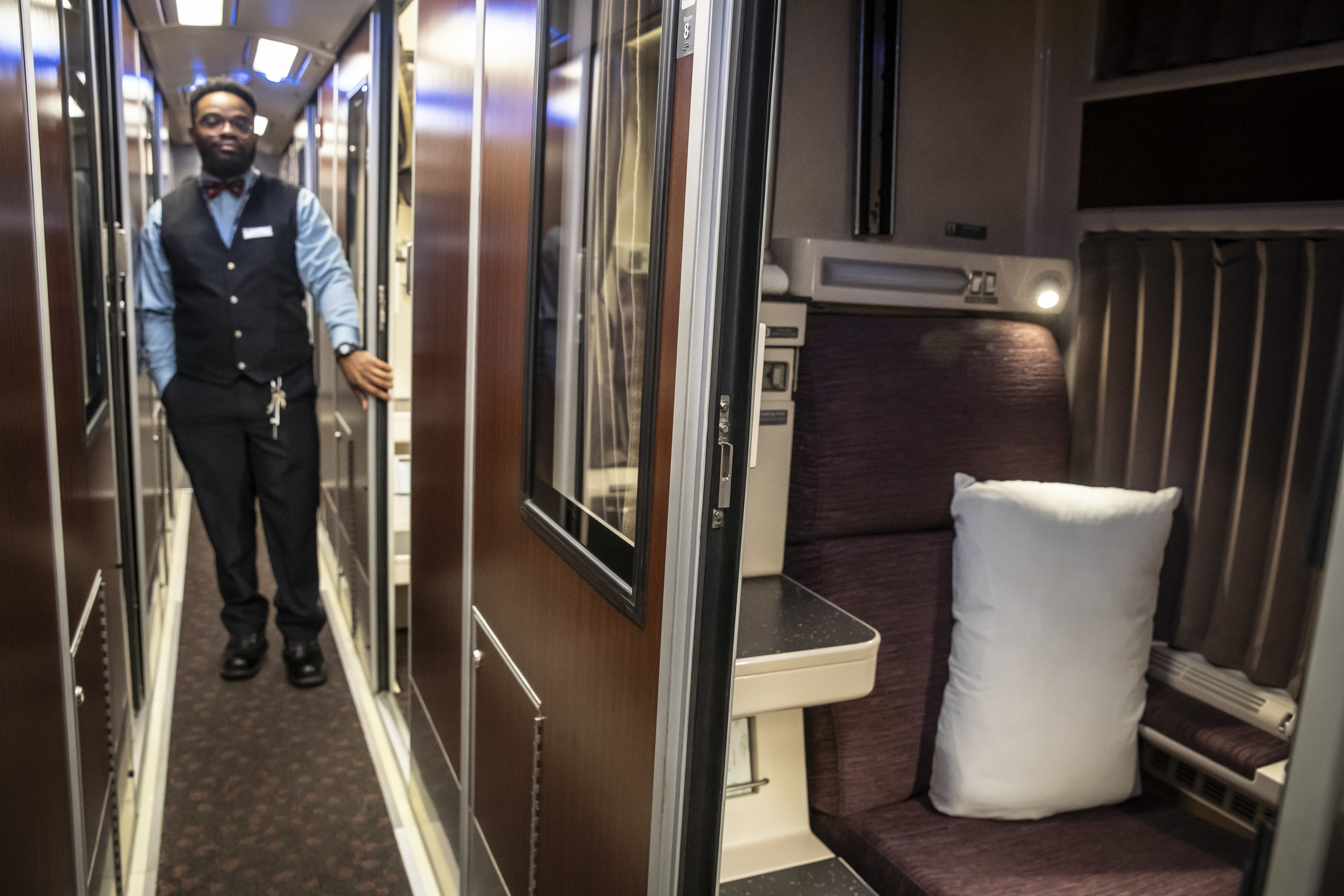 "Amtrak service attendant Emory Sangster shows a ""roomette'' in the railroad's new Viewliner II sleeper cars."