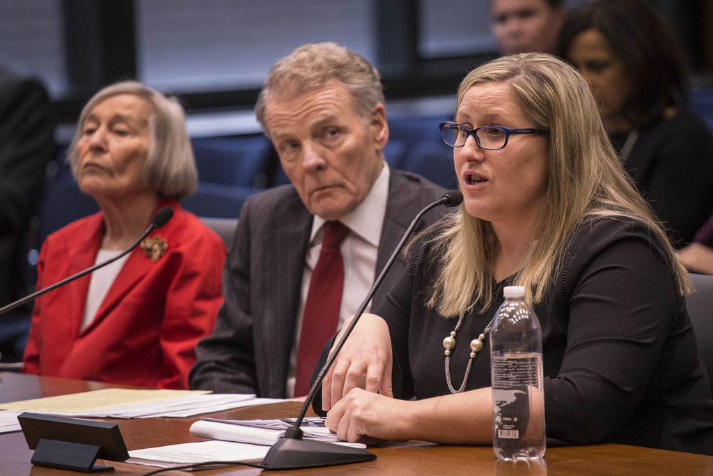 Speaker Mike Madigan, center, listens as Special Counsel Heather Wier Vaught, right, speaks