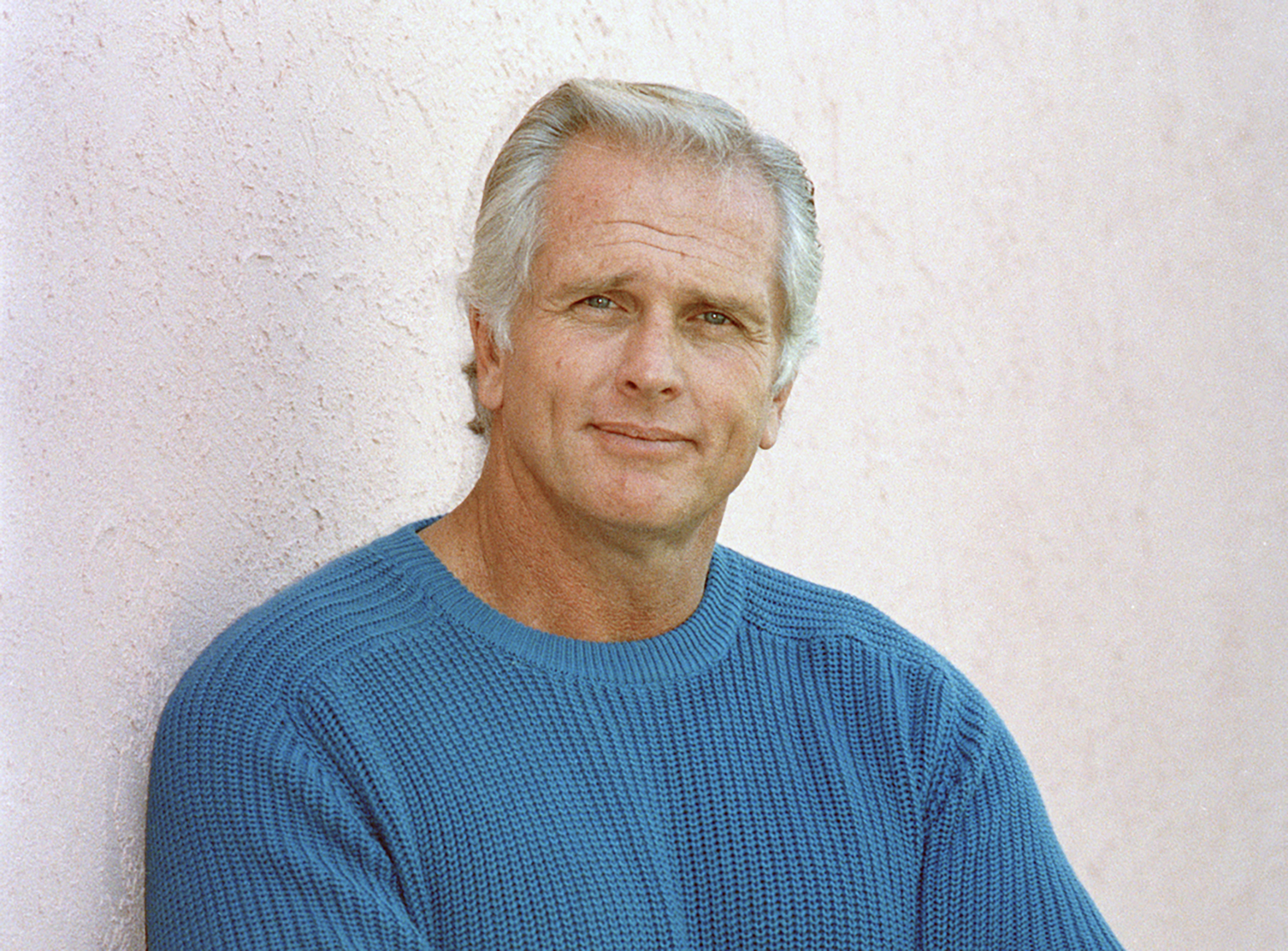 "Former ""Tarzan"" actor Ron Ely is photographed in 1987 during an interview in Los Angeles."