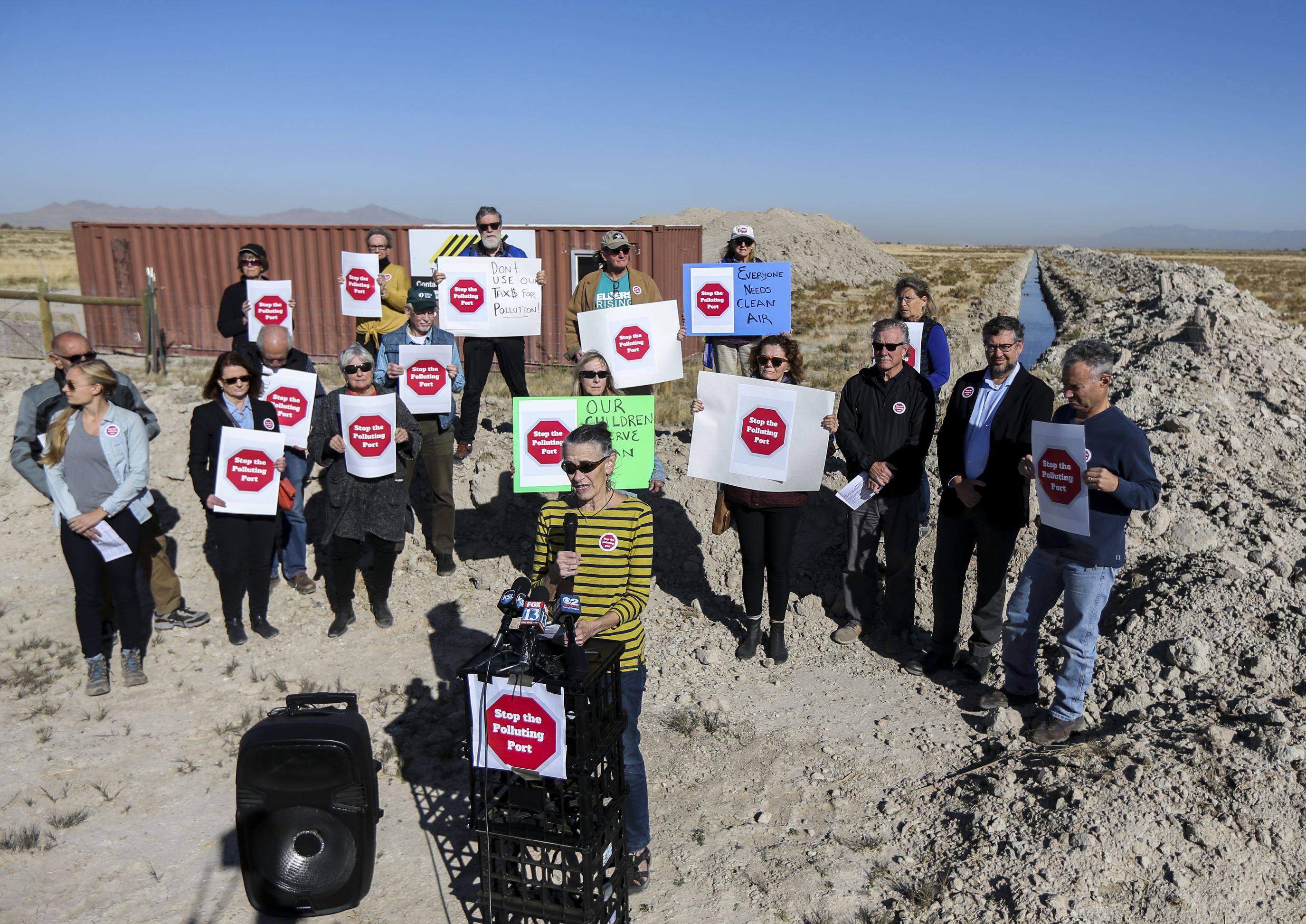 Heather Dove, president of the Great Salt Lake Audubon Society, front center, speaks during a press conference held west of the Salt Lake City International Airport on Wednesday, Oct. 16, 2019. The group Stop the Polluting Port called for the halt of development on about 16,000 acres west of the airport, an area under the jurisdiction of the state-created Utah Inland Port Authority but also near sensitive wetland and migratory bird habitat.