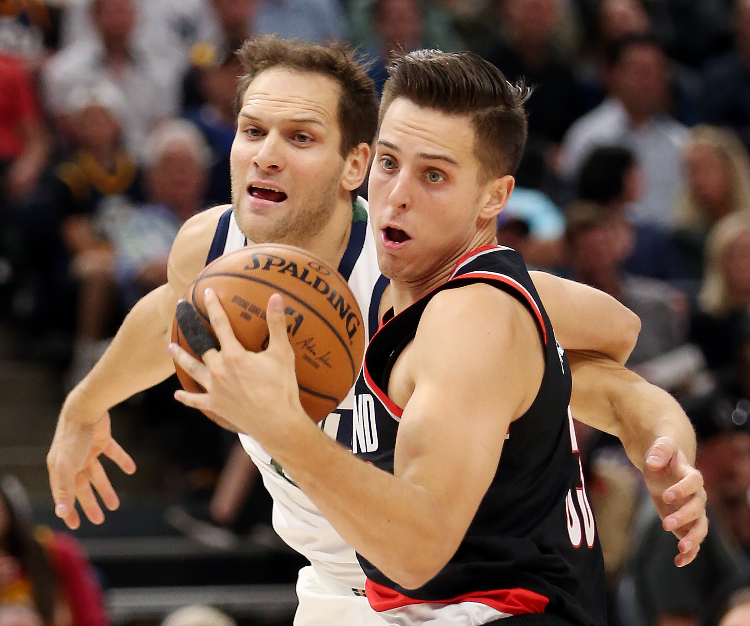 Portland Trail Blazers forward Zach Collins (33) catches a pass over Utah Jazz forward Bojan Bogdanovic (44) as the Utah Jazz and the Portland Trail Blazers play a preseason game at Vivint Smart Home Arena in Salt Lake City on Wednesday, Oct. 16, 2019.