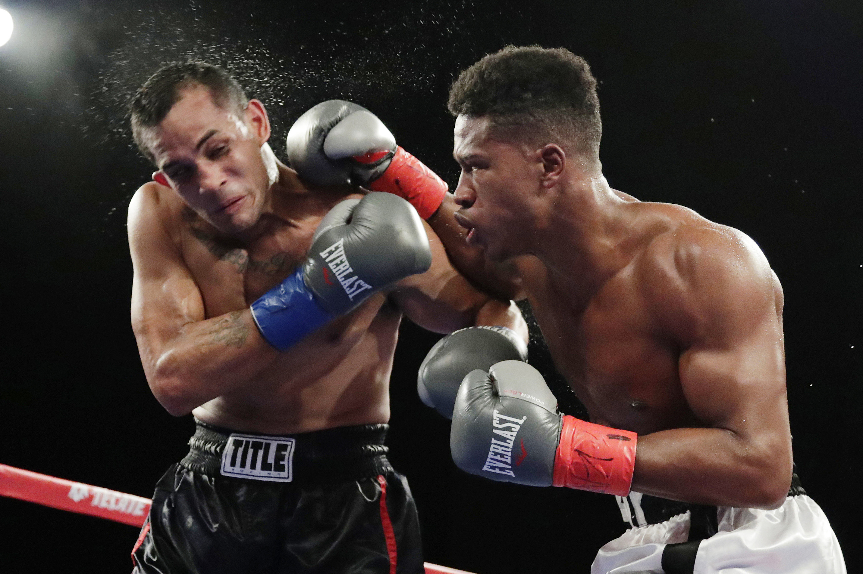 Patrick Day punches Elvin Ayala during the fifth round of a WBC super welterweight boxing bout in New York.