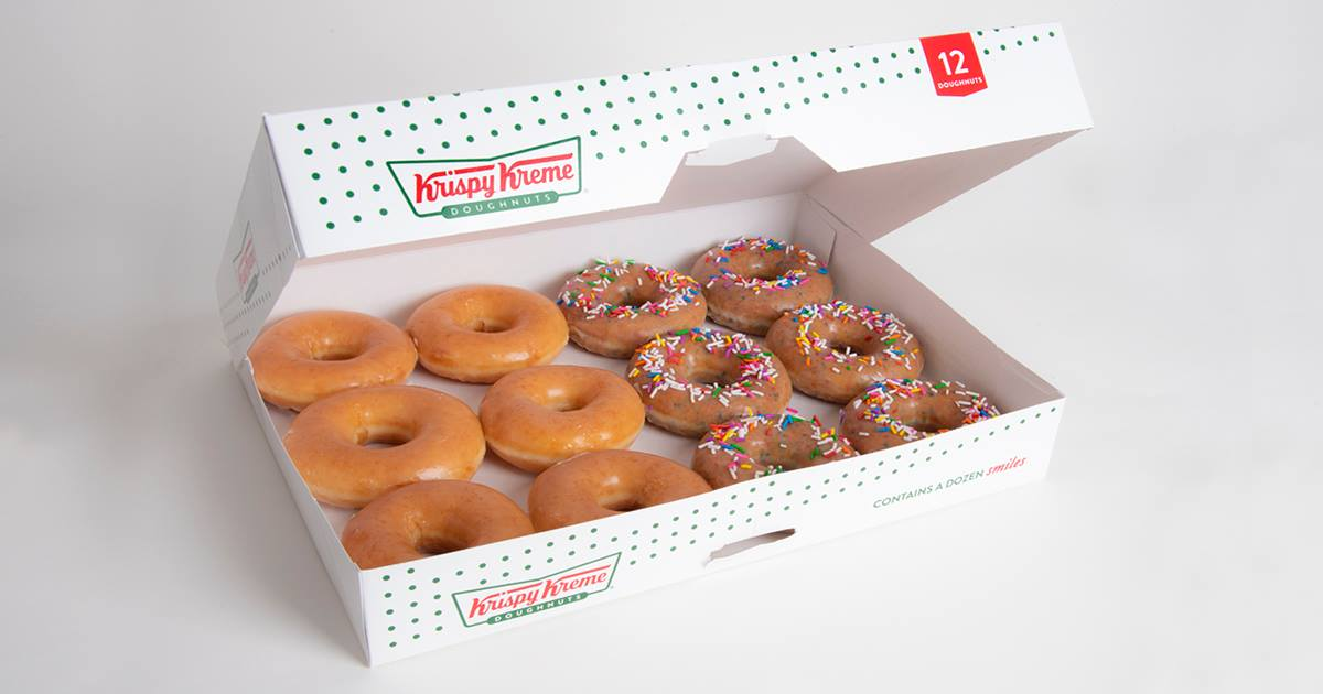 A box of a dozen glazed and sprinkle doughnuts
