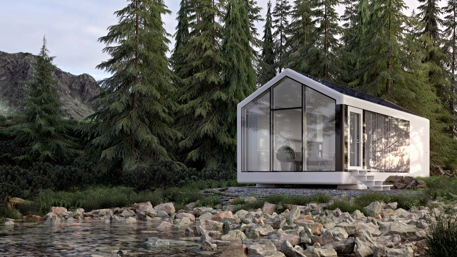A pitch-roofed house with glass walls on a rocky shore with evergreen trees in the back.