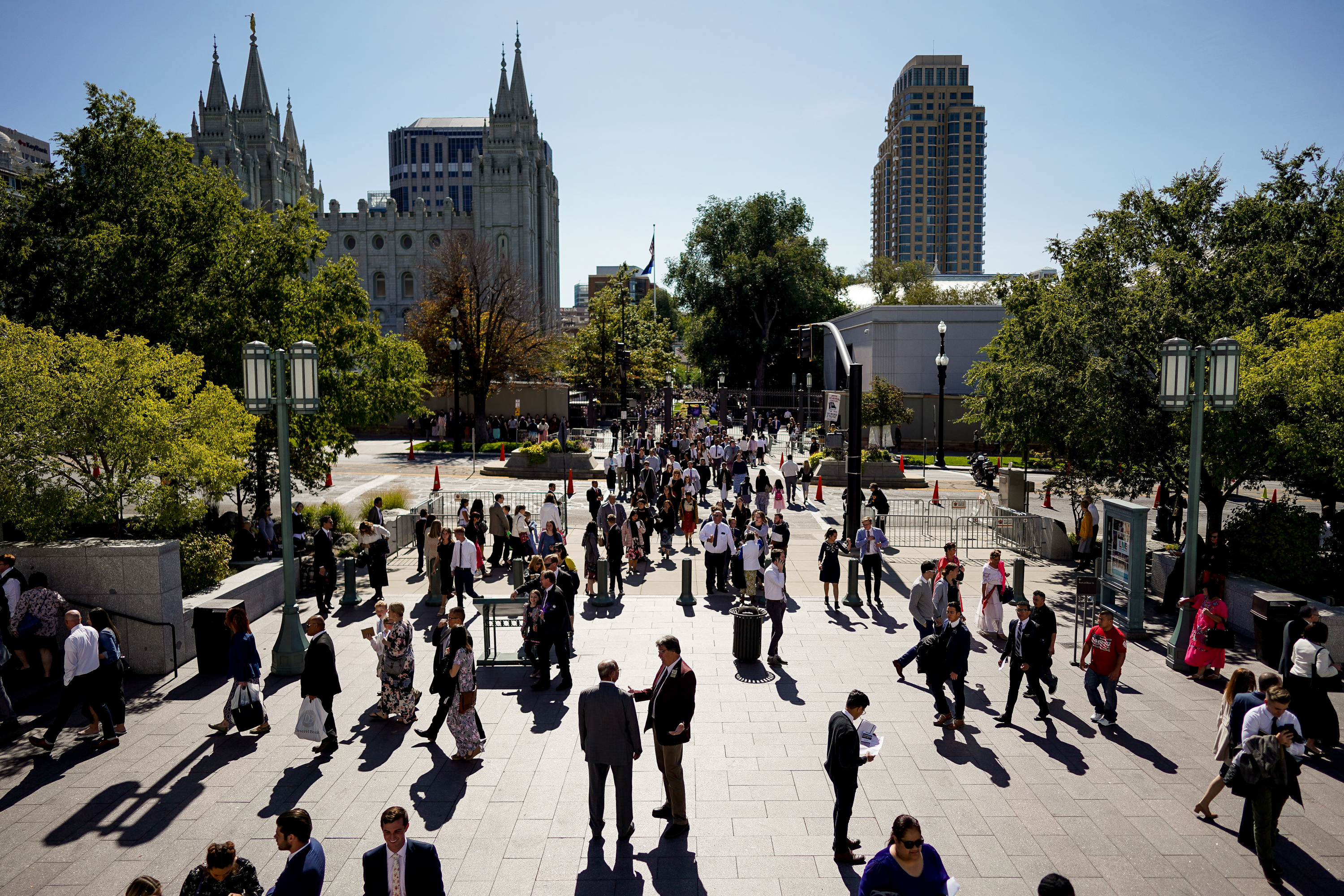 People walk around between Temple Square and the Conference Center between morning and afternoon sessions of the 189th Semiannual General Conference of The Church of Jesus Christ of Latter-day Saints in the Conference Center in Salt Lake City on Saturday, Oct. 5, 2019.