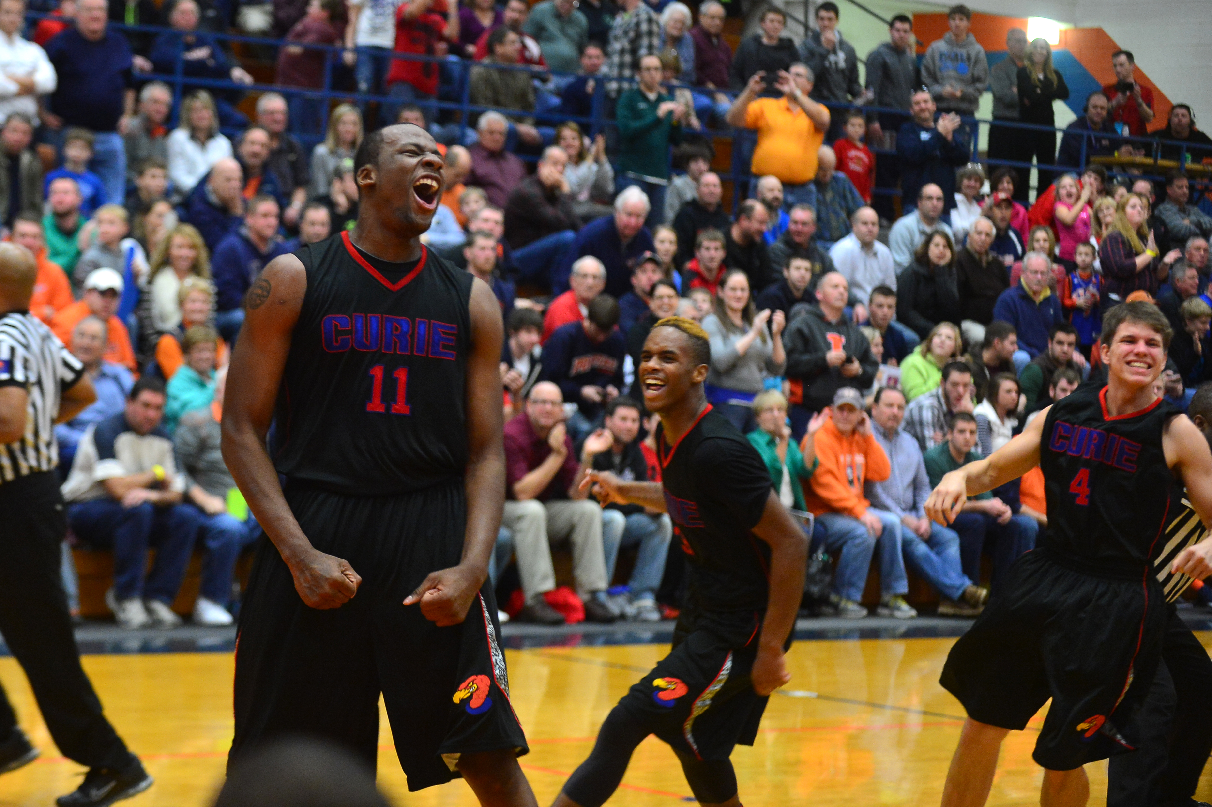 Curie's Cliff Alexander screams with teammates after defeating Simeon.