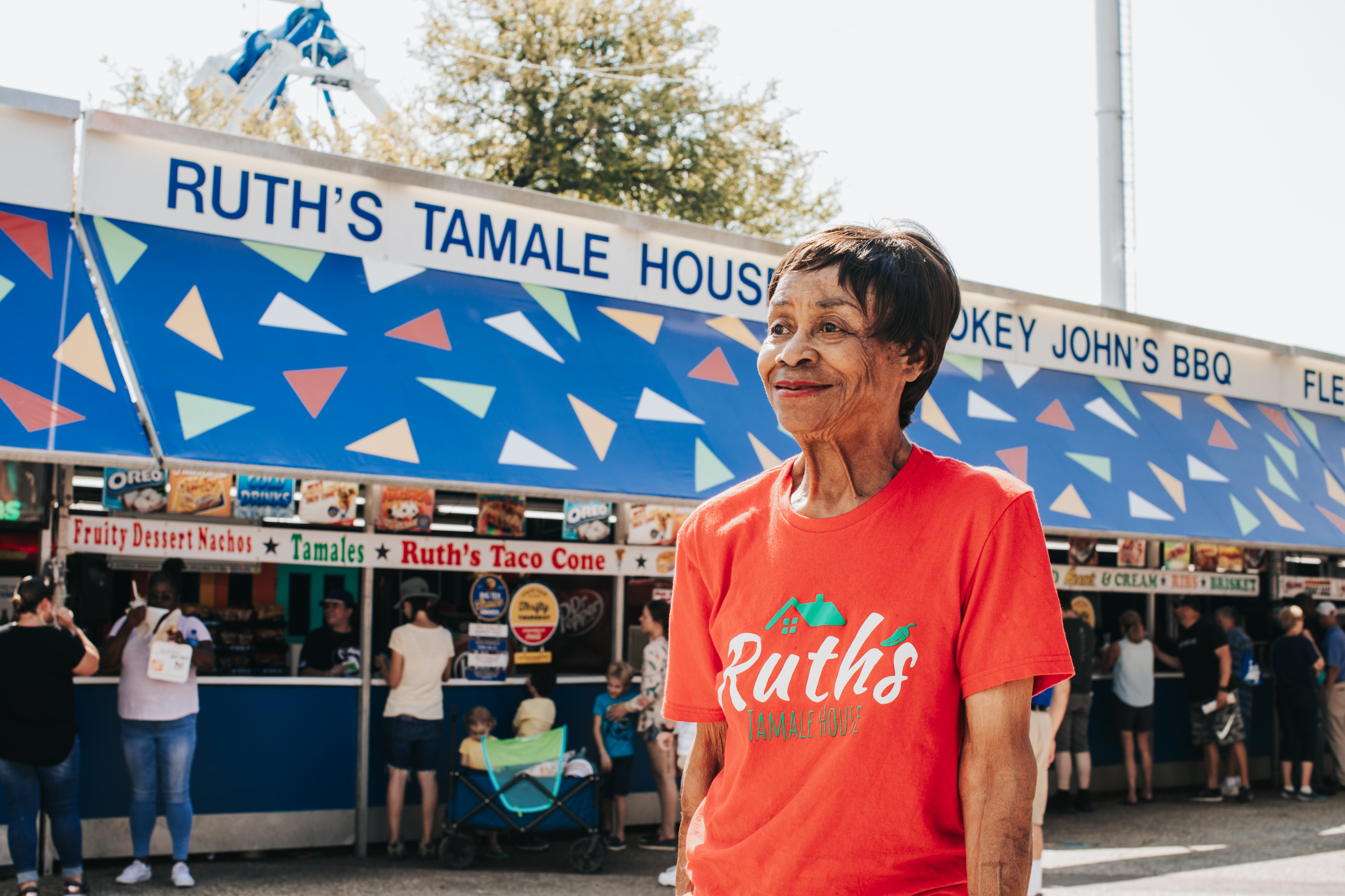 Ruth Hauntz smiles while standing in front of her Ruth's Tamale House stand.