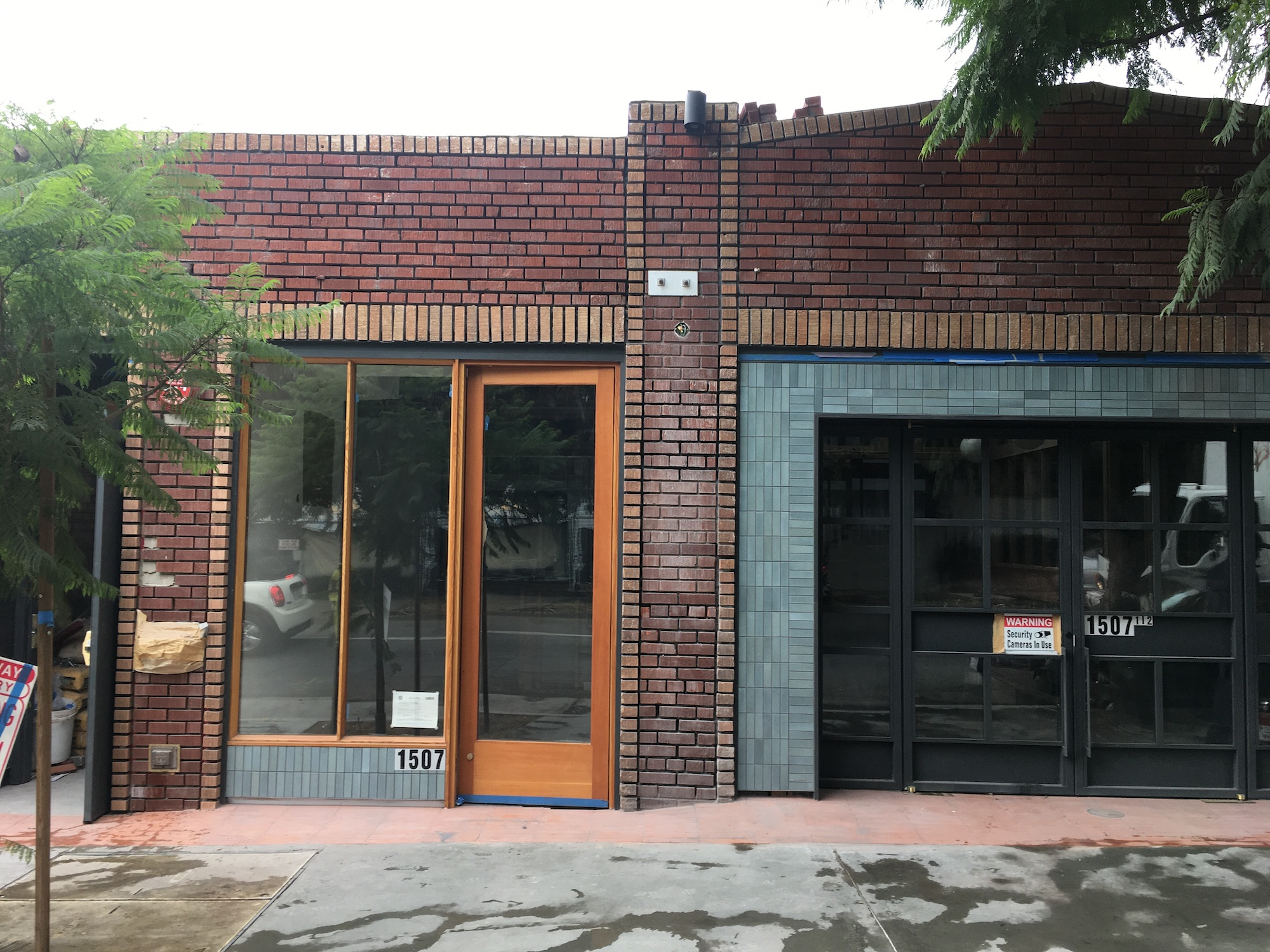 A brick exterior of an under-construction restaurant space.
