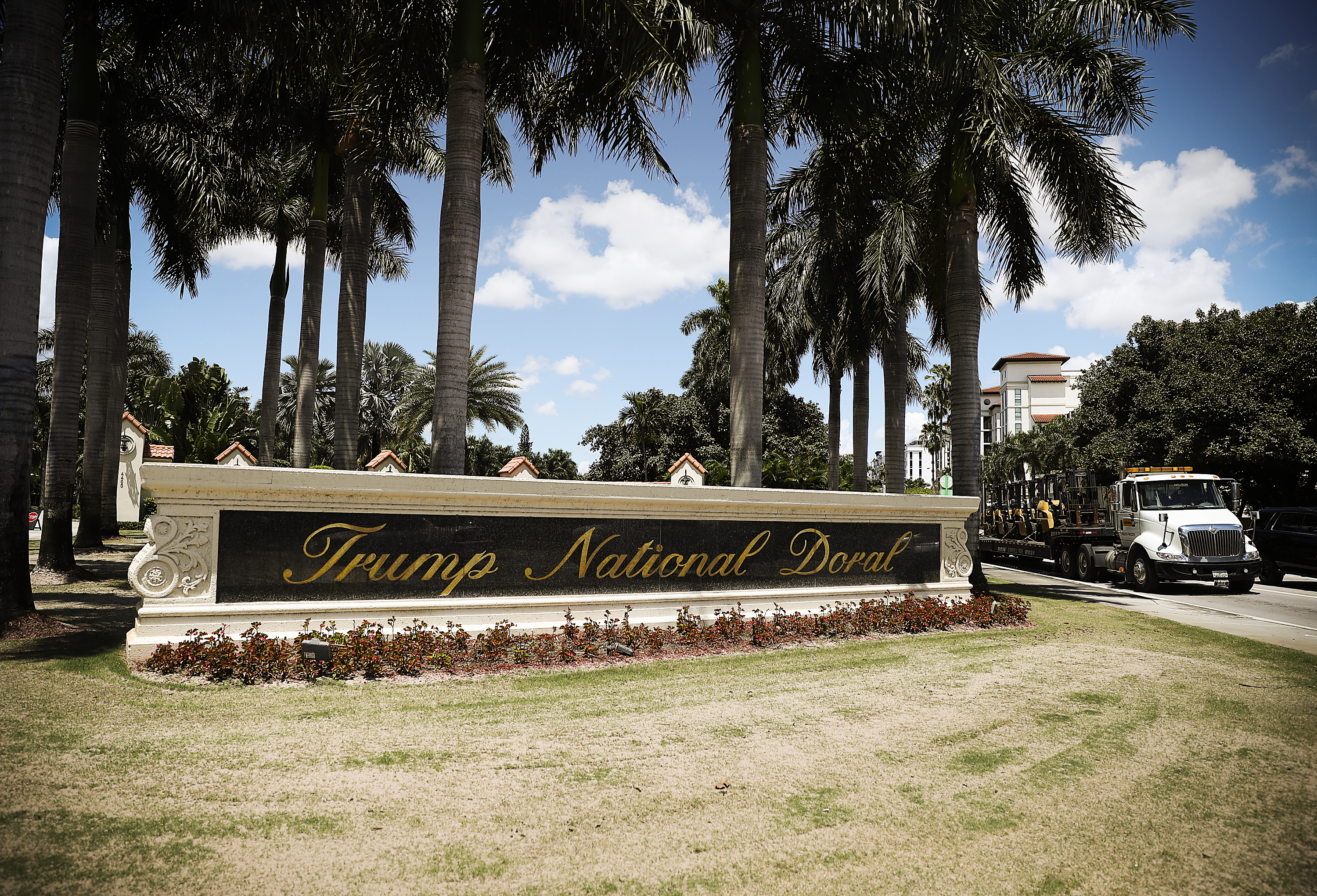 Palm trees surround the sign outside the Trump National Doral golf resort in Doral, Florida.