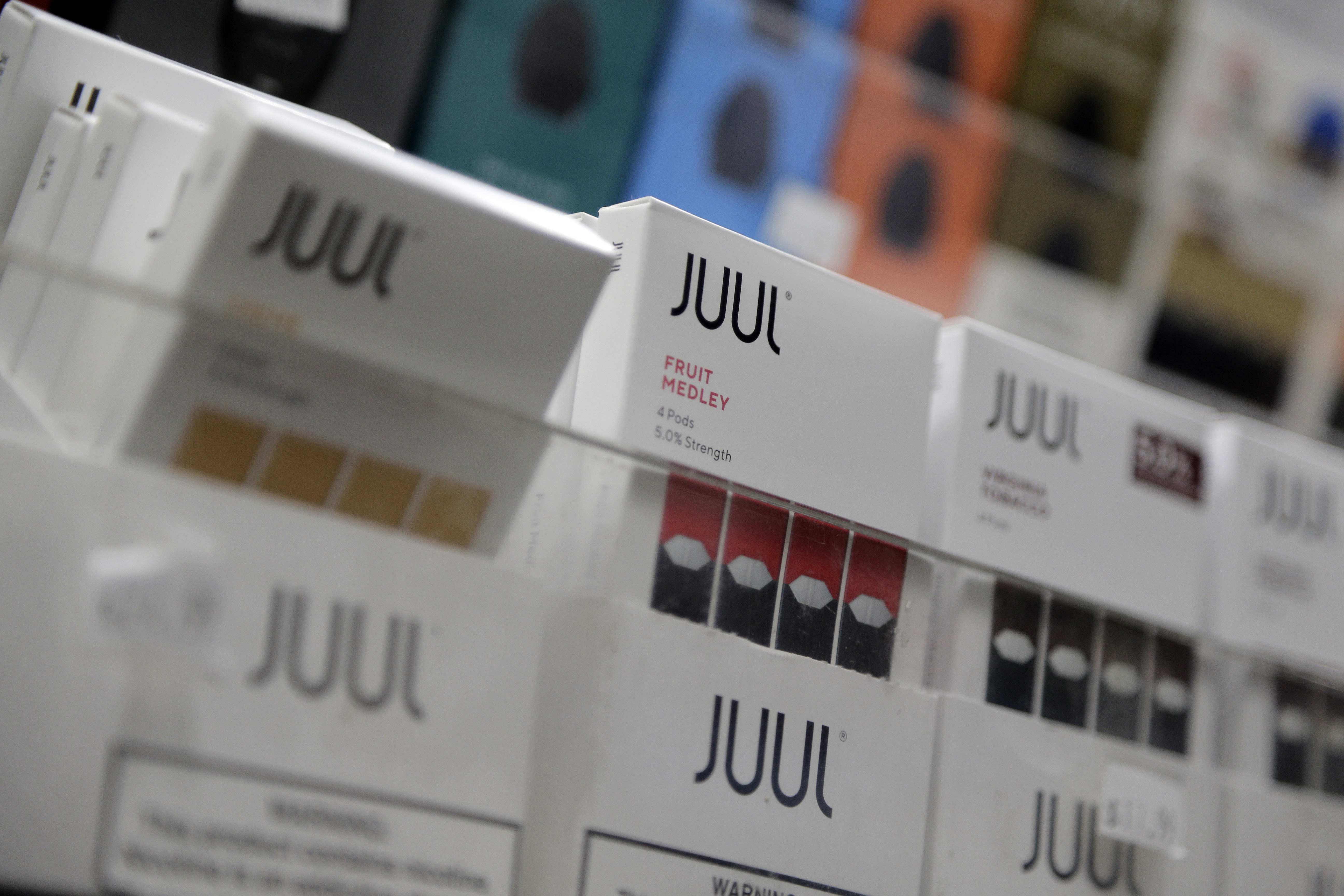 FILE - In this Dec. 20, 2018, file photo Juul products are displayed at a smoke shop in New York. Under scrutiny amid a wave of underage vaping, Juul is pushing into television with a multimillion-dollar campaign rebranding itself as a stop-smoking aid fo