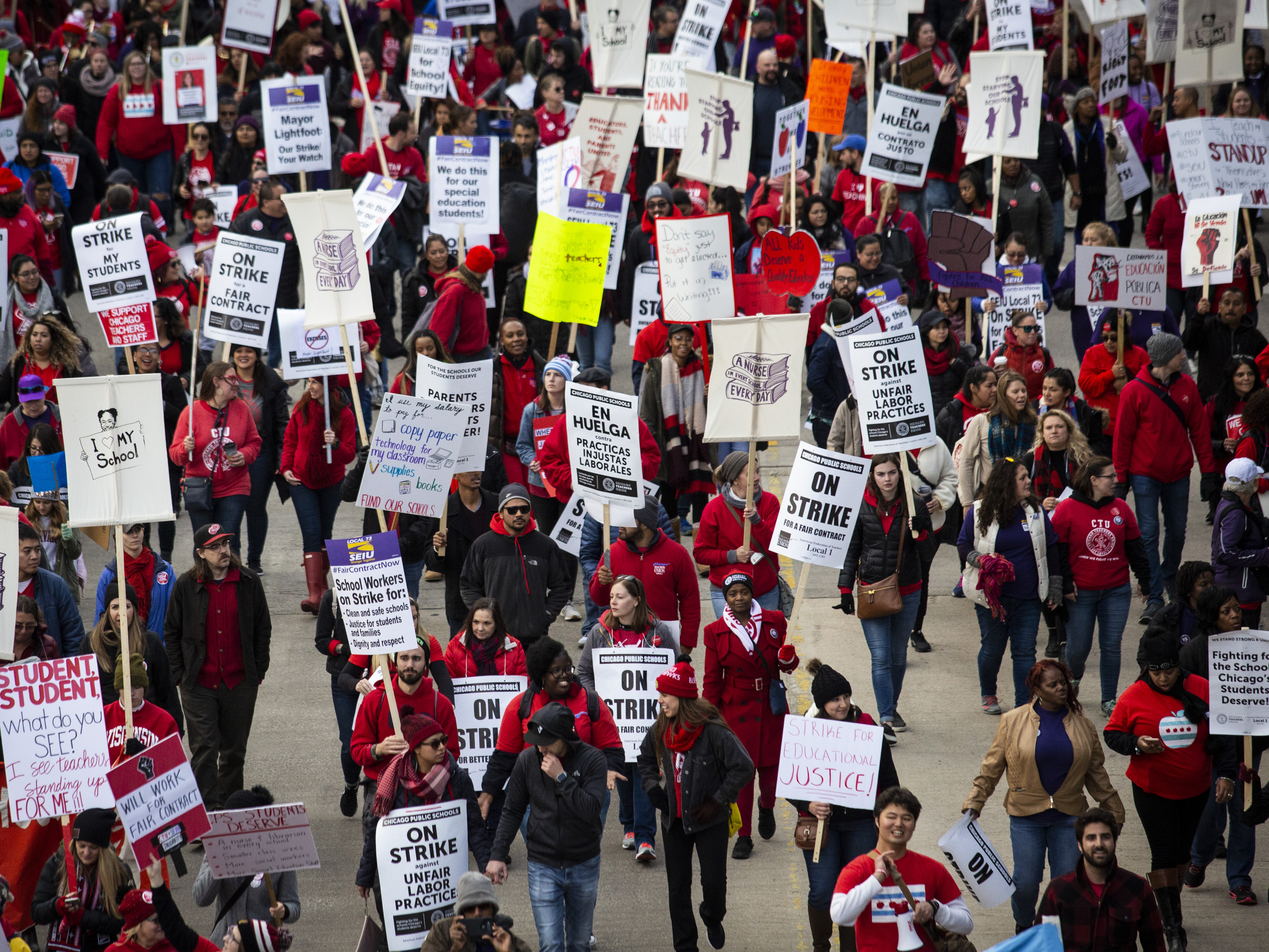 Thousands of striking Chicago Teachers Union members and their supporters march through the Loop, Thursday afternoon, Oct. 17, 2019.