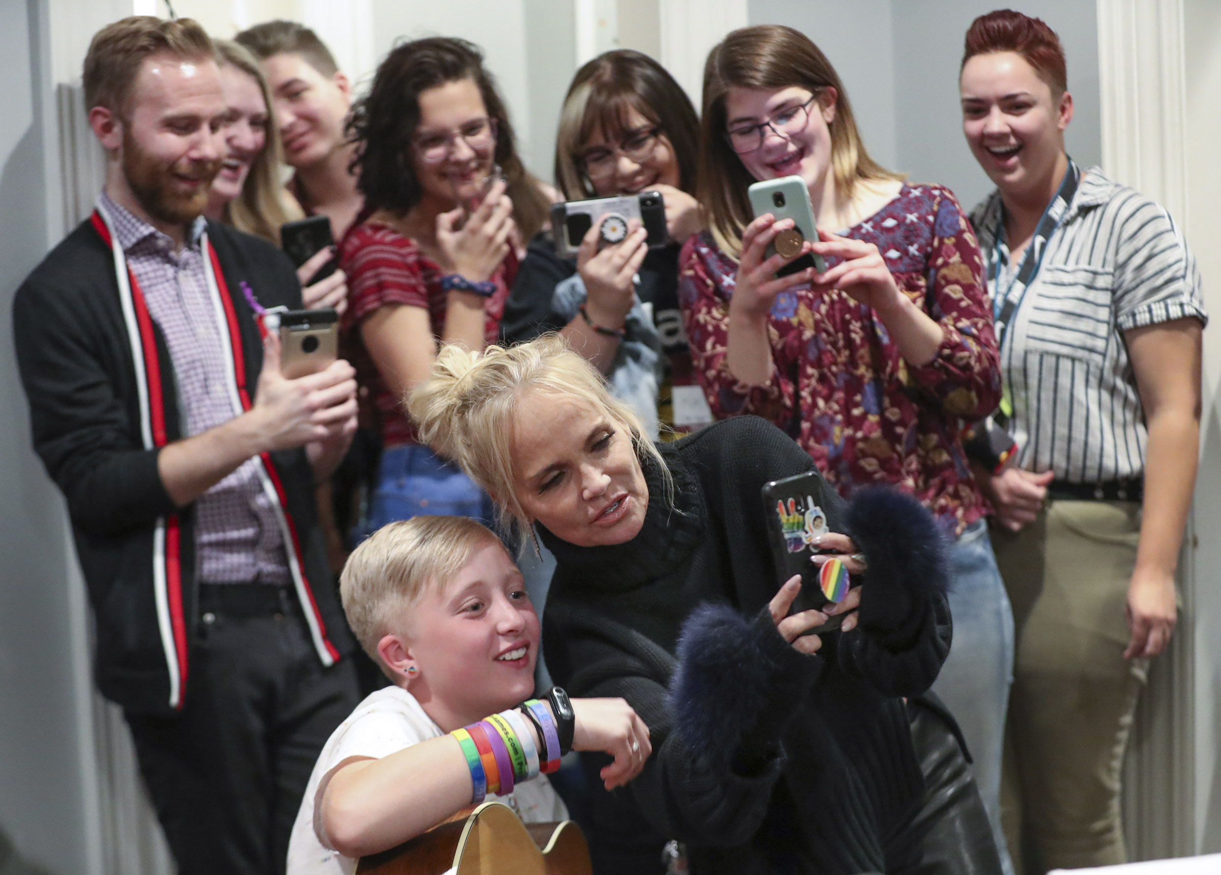Actress Kristin Chenoweth poses for a selfie with Keeley Milner, who was celebrating her 12th birthday, as she sings during the Encircle SLC weekly music night in Salt Lake City on Thursday, Oct. 17, 2019. Encircle provides programs and other services for LGBTQ individuals to find information and support.