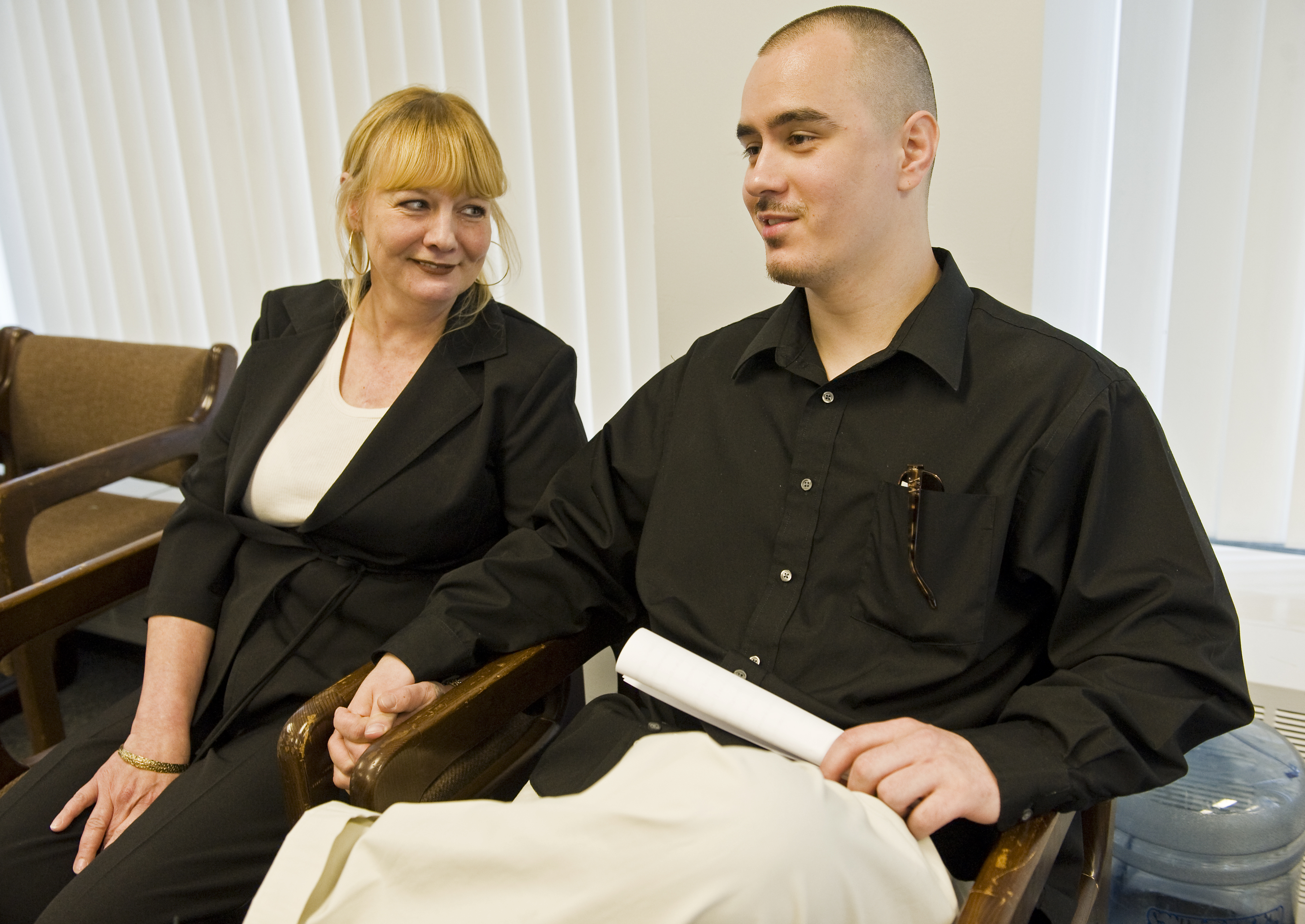 Thaddeus Jimenez, 30, sits with his mom Victoria Jimenez