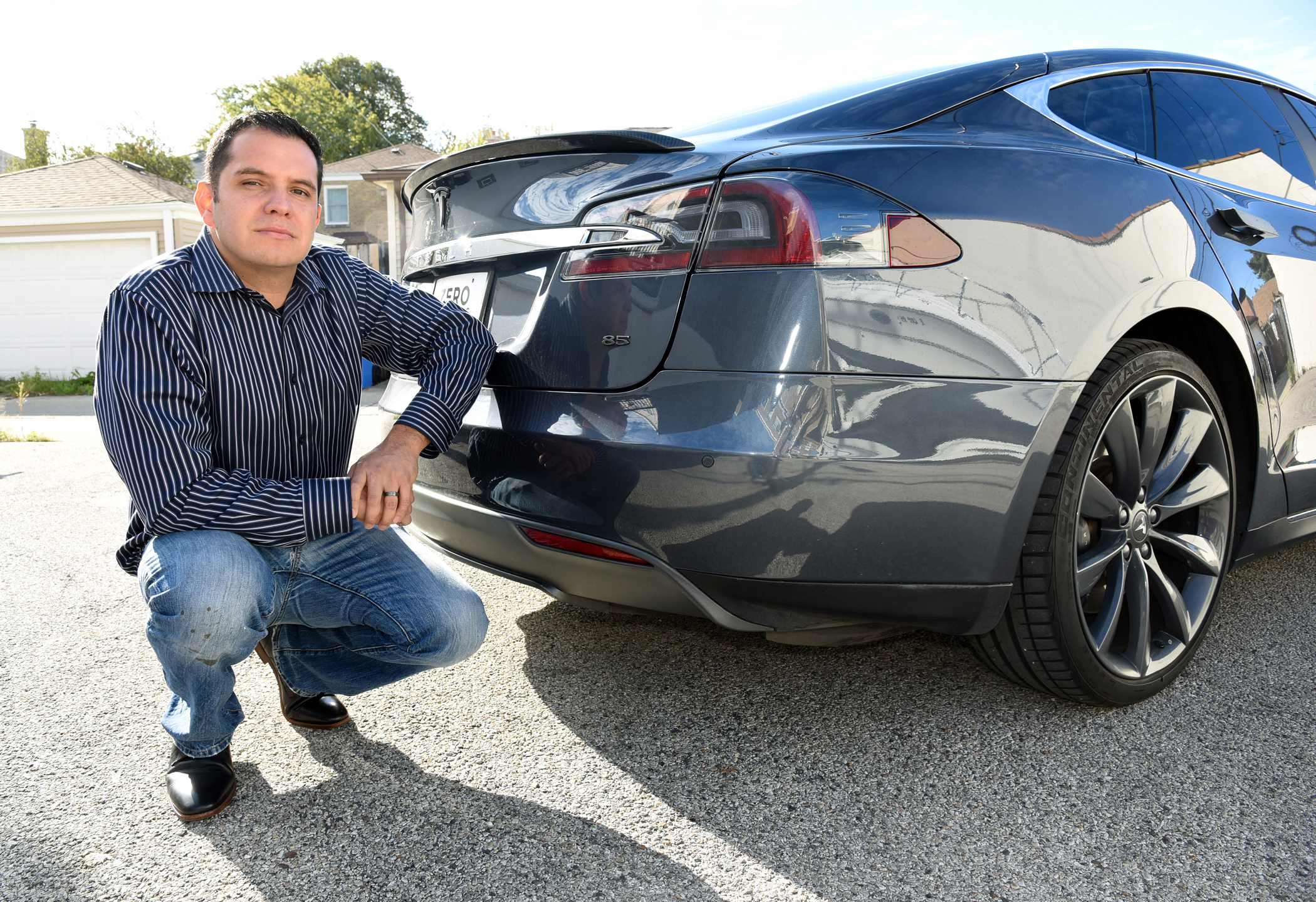 Guillermo Perez, a Chicago firefighter, says his 2014 Tesla Model S85 saw a sudden drop in range after an automatic software update to the battery system.