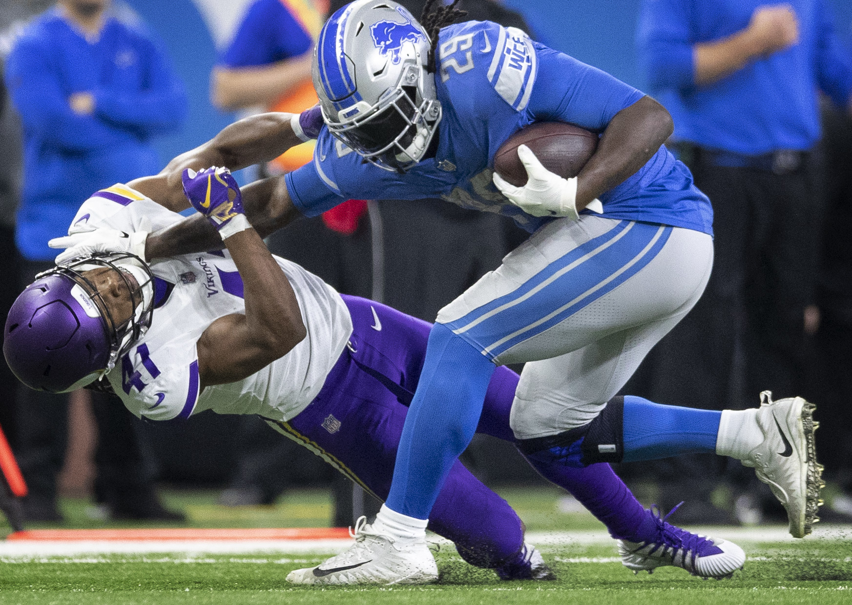 Detroit Lions running back LeGarrette Blount (29) stiff armed Minnesota Vikings defensive back Anthony Harris (41) for a first down in the forth quarter at Ford Field Sunday December 23, 2018 in Detroit, MI.] The Minnesota Vikings beat the Detroit Lions
