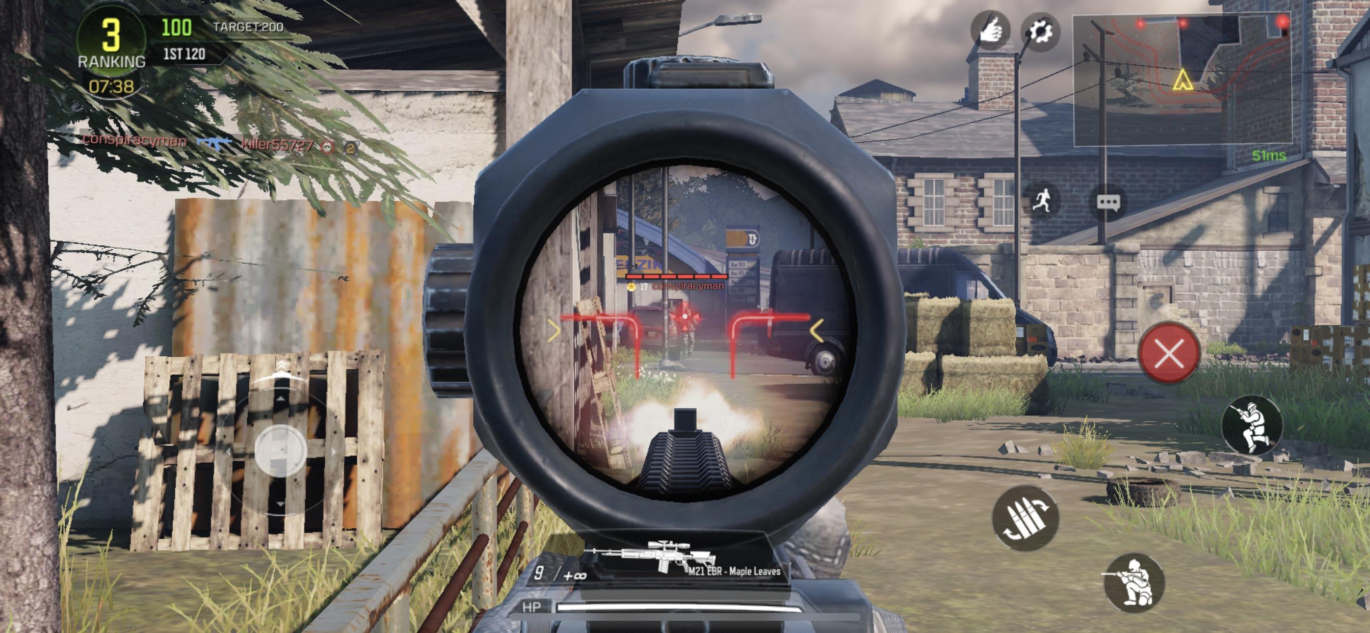 A soldier looks at their target through a gun scope