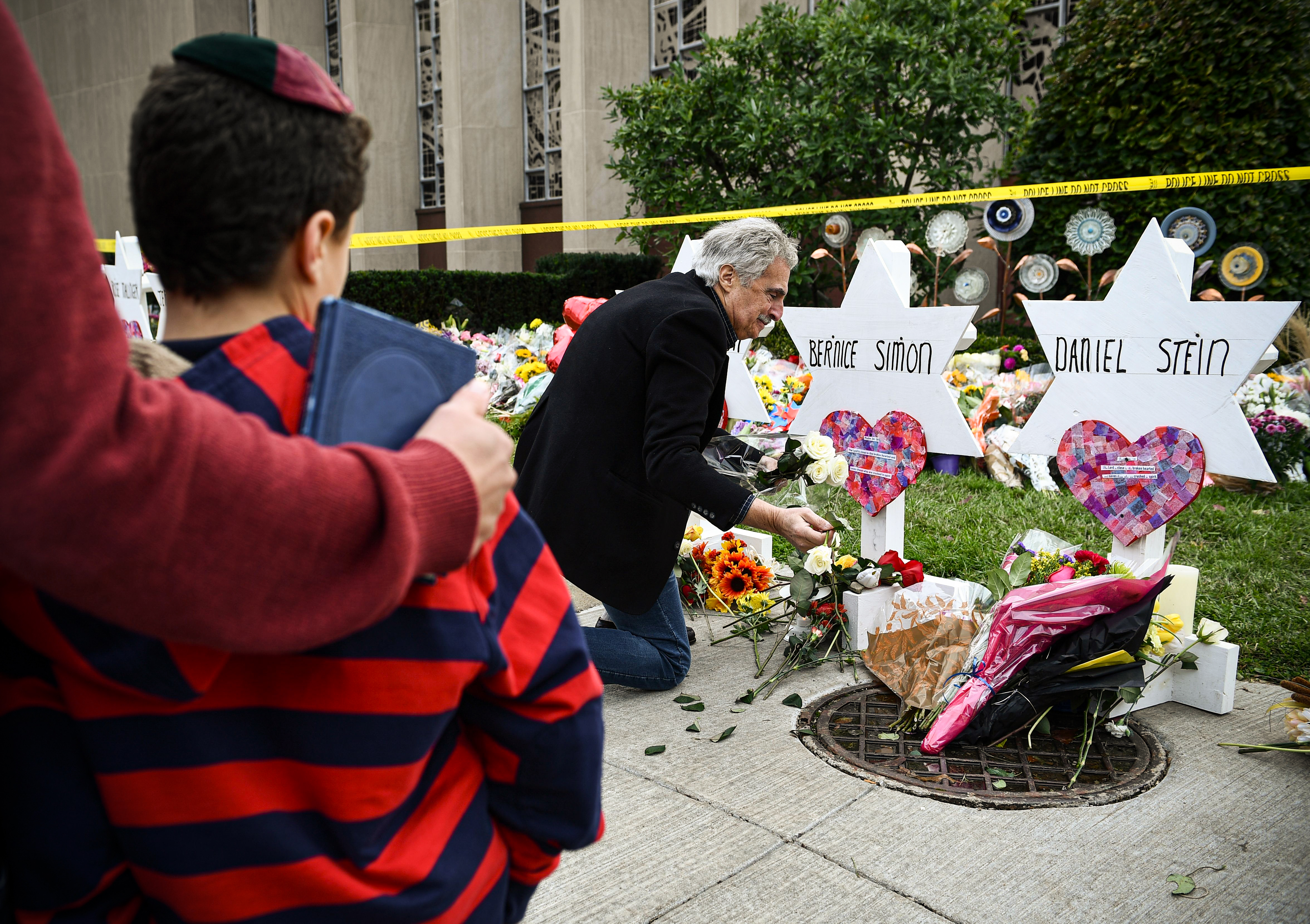 People leave flowers and other mementos at a memorial outside Pittsburgh's Tree of Life synagogue.