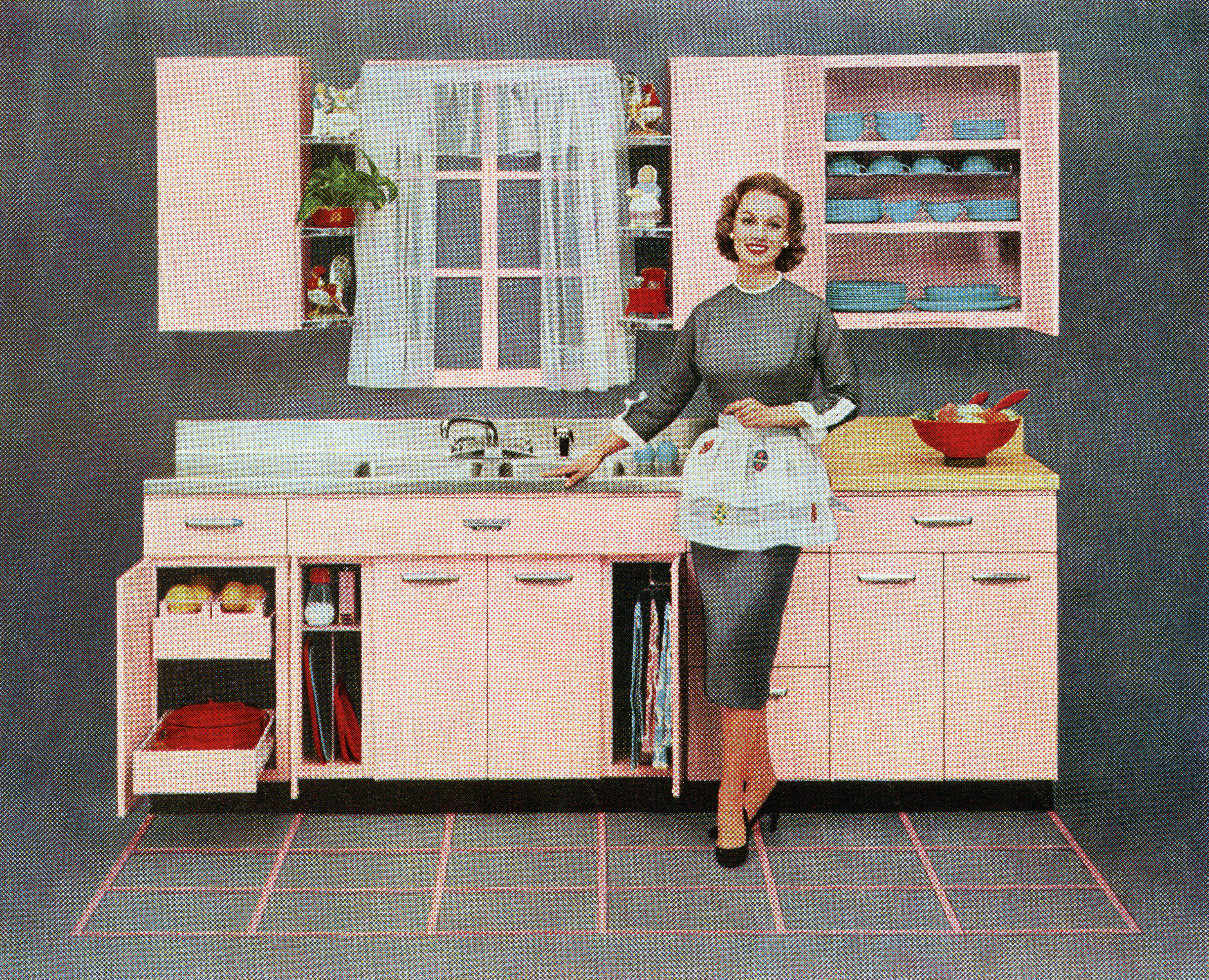 Vintage illustration of a fashionable housewife standing in front of her new pink kitchen, 1957.