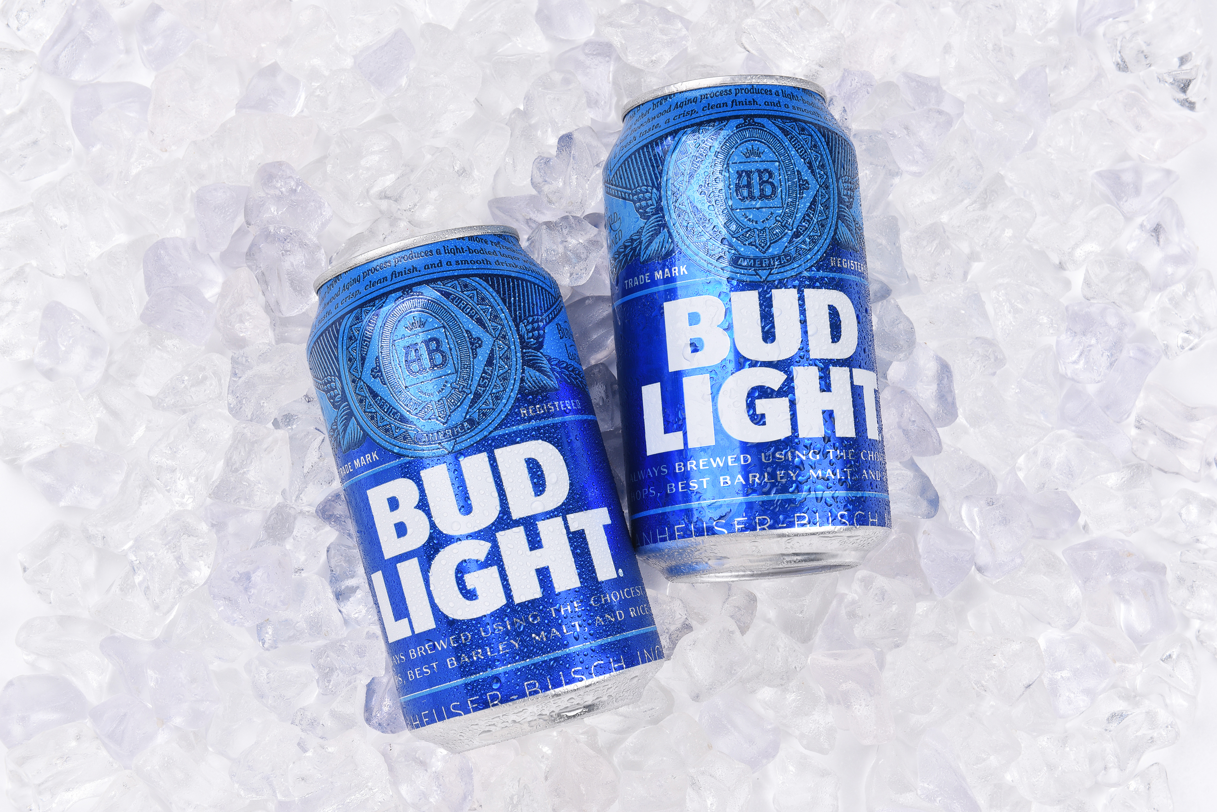 Two cans of bud light on a bed of ice