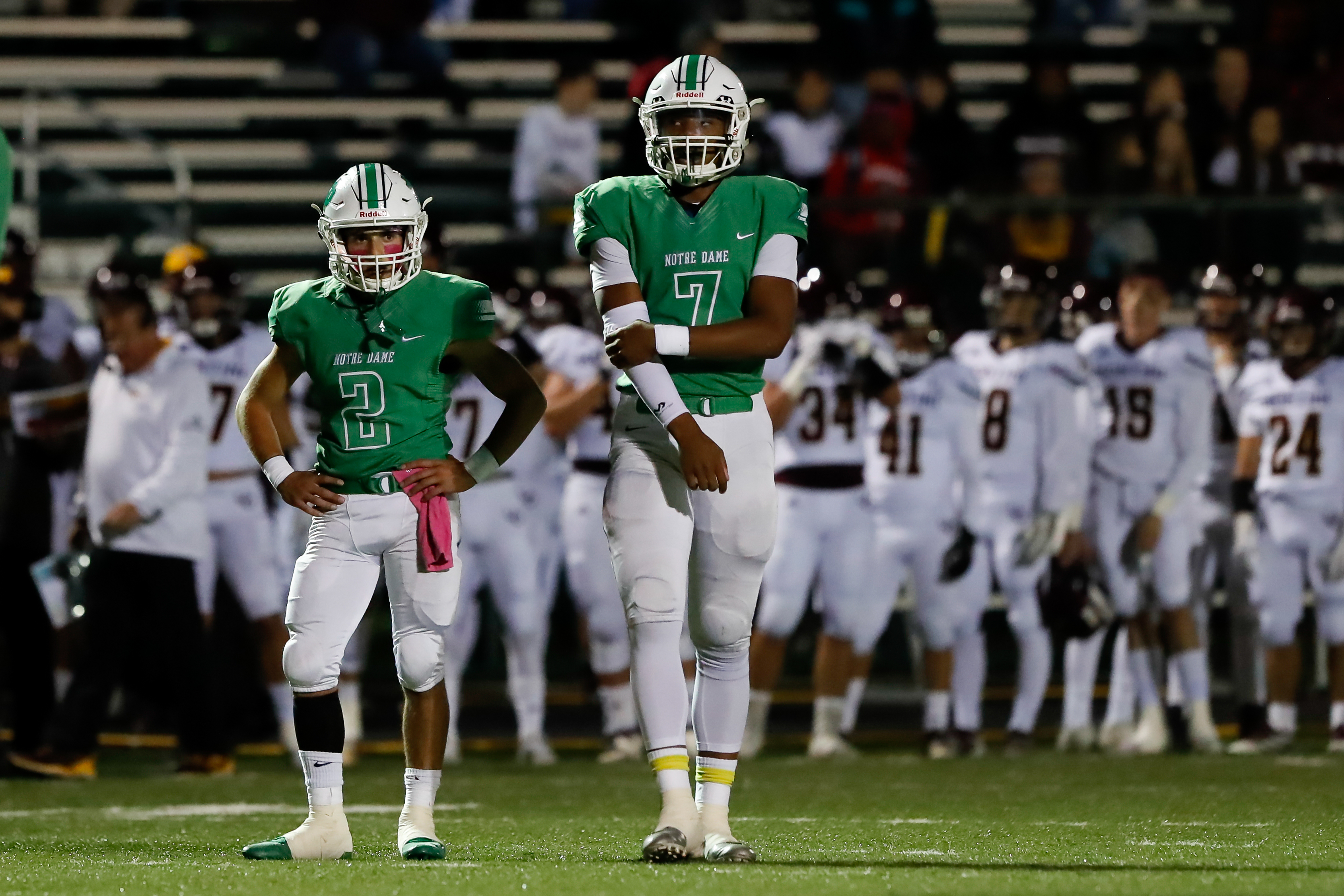 Notre Dame's Julian Schurr (2) and Anthony Sayles (7) wait for play to resume during the game against Montini.