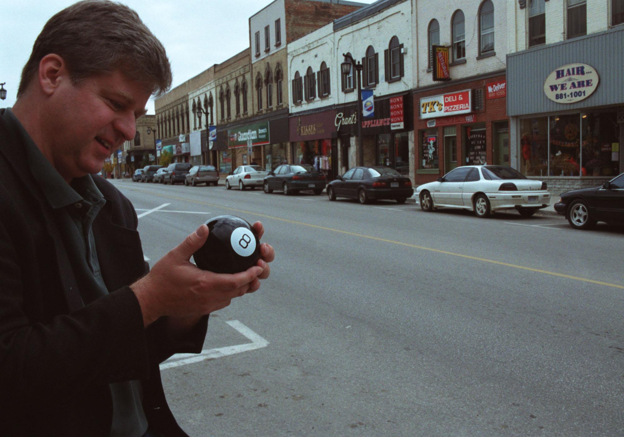 Man holding Magic 8 Ball toy