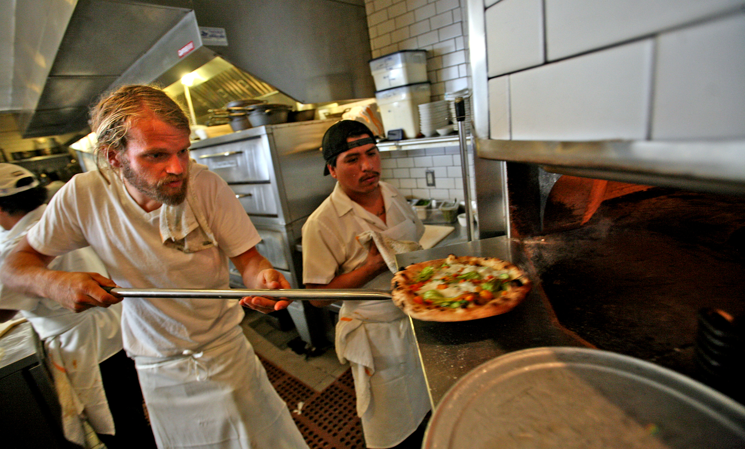 Chef Travis Lett pulls a pizza from the oven, at Gjelina restaurant in Venice on APRIL 27, 2011.