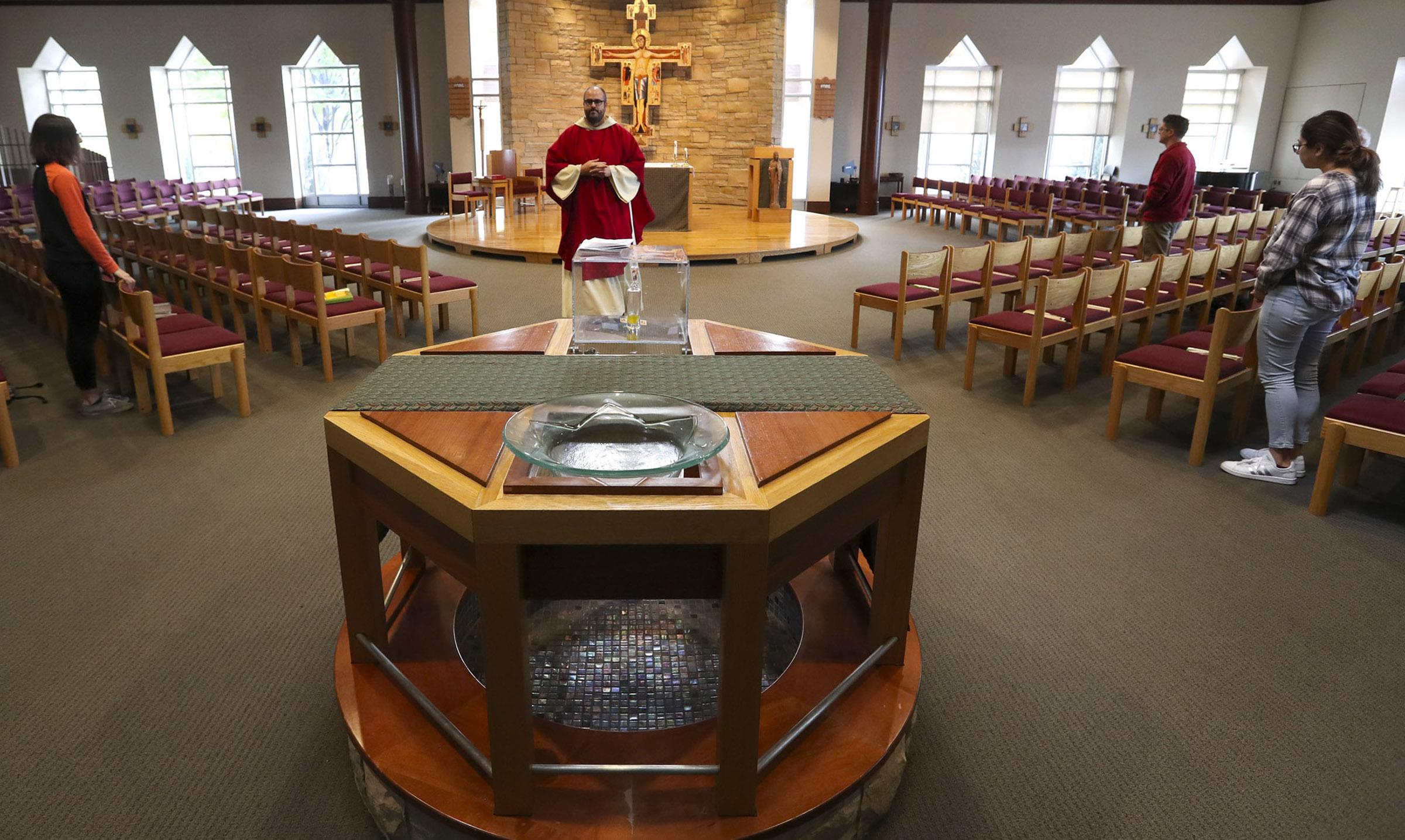 Father Cody Jorgensen celebrates Mass at the St. Catherine of Siena University Parish and Newman Center in Salt Lake City on Friday, Oct. 18, 2019.