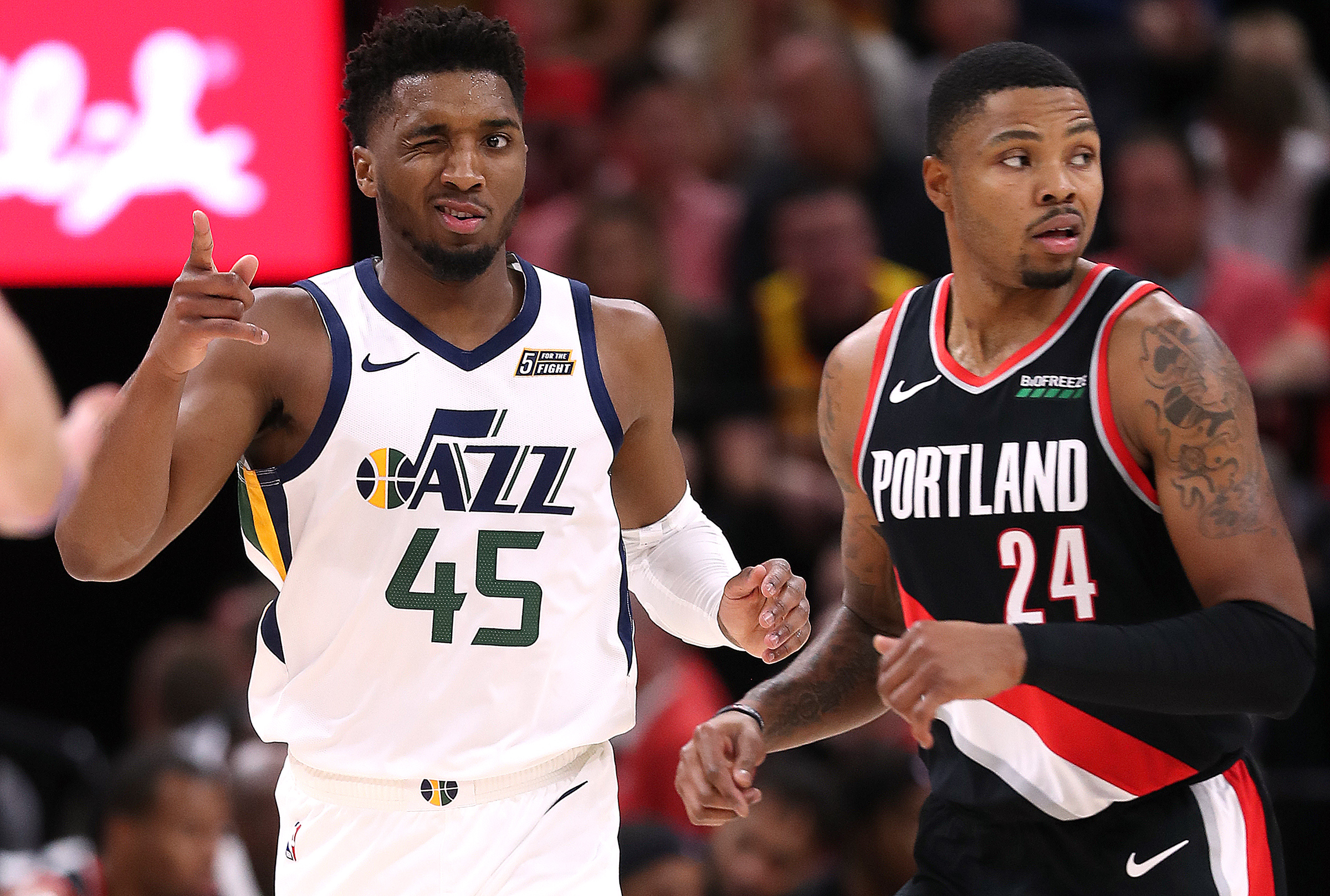 Utah Jazz guard Donovan Mitchell (45) winks at teammate Joe Ingles (2) as the Utah Jazz and the Portland Trail Blazers play at Vivint Smart Home Arena in Salt Lake City on Wednesday, Oct. 16, 2019.