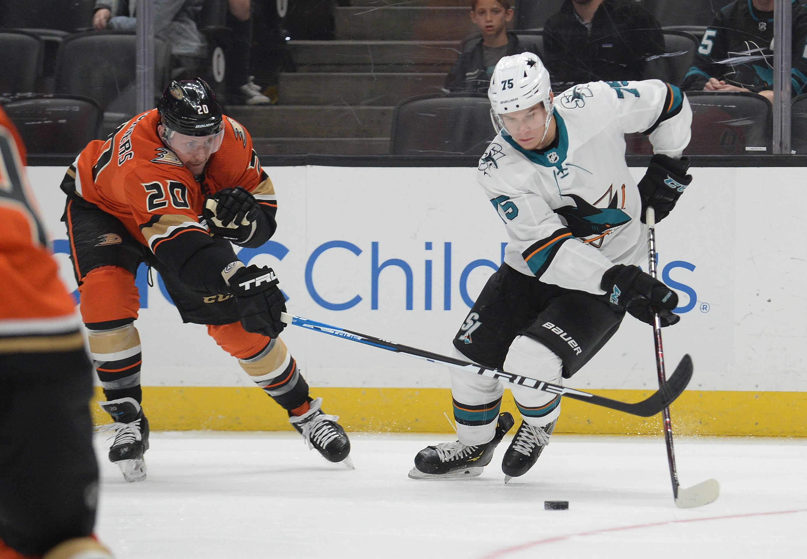 October 5, 2019; Anaheim, CA, USA; San Jose Sharks left wing Danil Yurtaykin (75) moves the puck against Anaheim Ducks left wing Nicolas Deslauriers (20) during the first period at Honda Center.