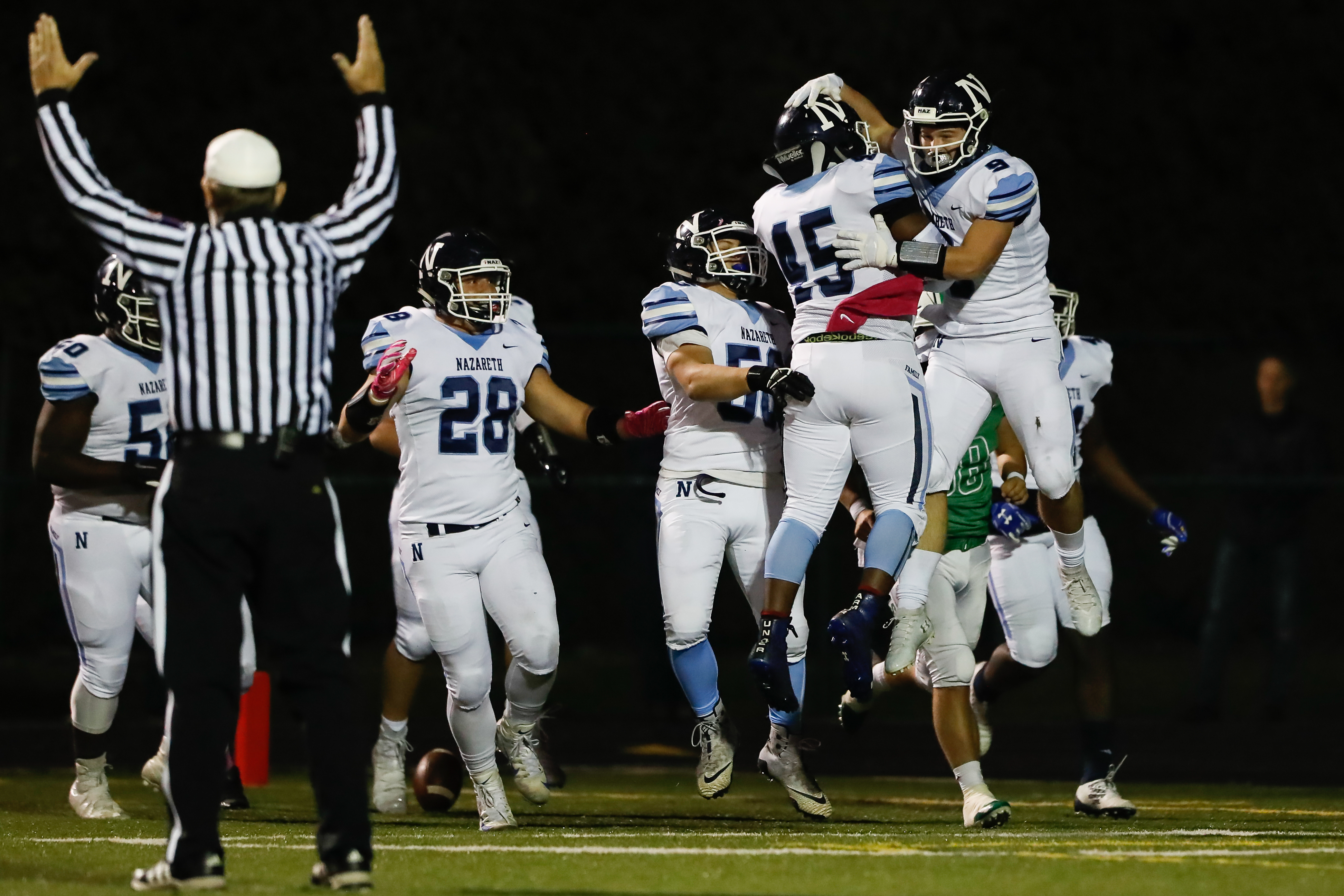 Nazareth's Breven Reifsteck (9) celebrates with his team after scoring a touchdown against Notre Dame.