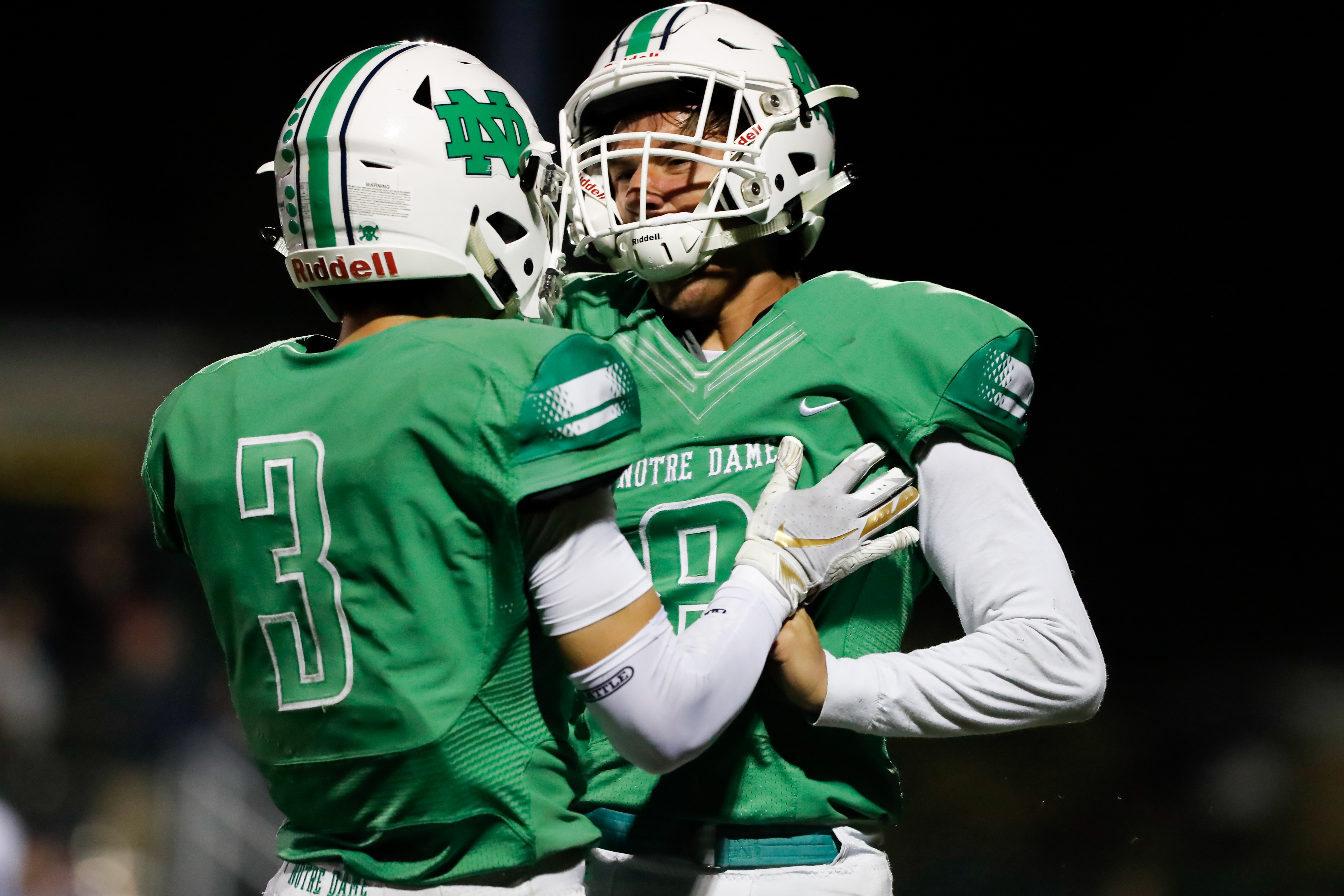 Notre Dame's Jordan Geroulis (8) reacts with Nick Giamarusti (3) during the game against Nazareth.