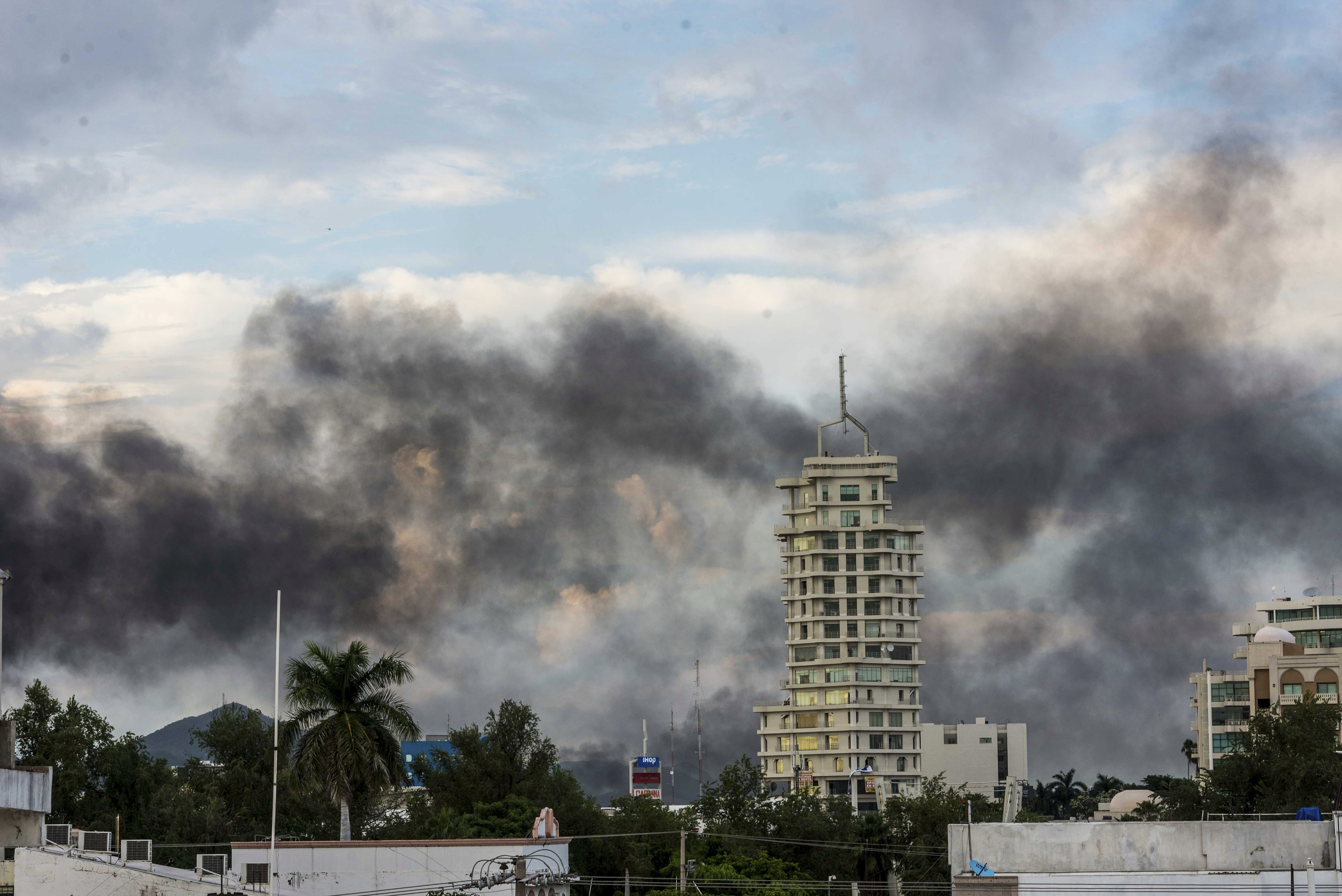 This Oct. 17, 2019 photo shows clouds of smoke from burning cars mar the skyline of Culiacan, Mexico.